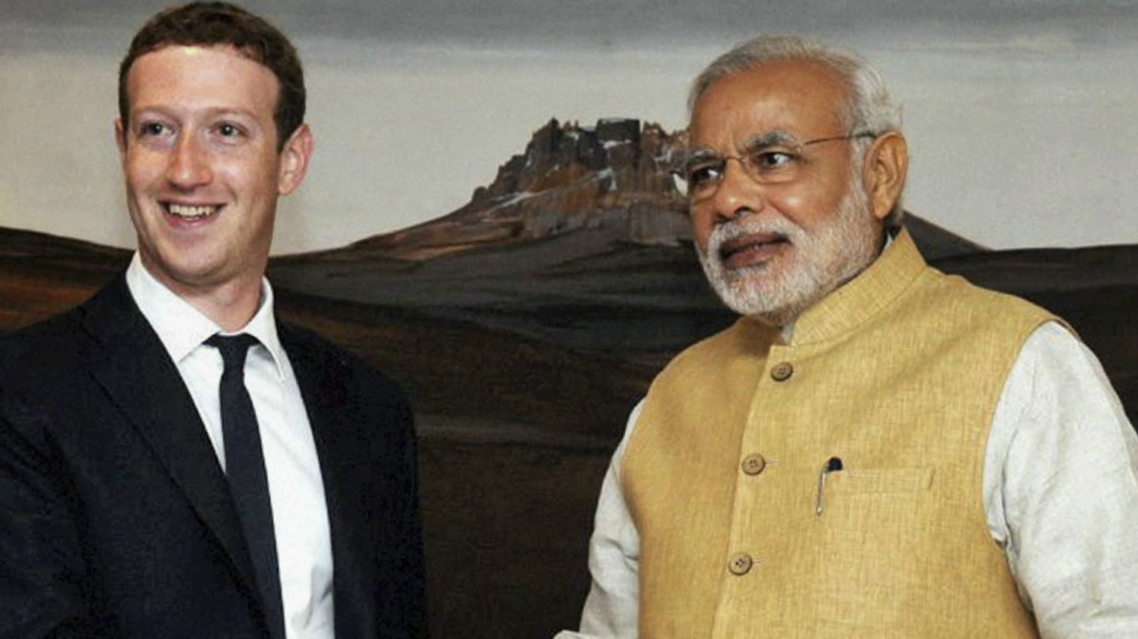 Indian Prime Minister Narendra Modi, right, shakes hands with Facebook CEO Mark Zuckerberg during a meeting in New Delhi, India, Friday, Oct. 10, 2014.
