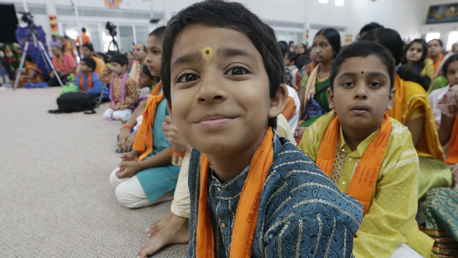 In this Saturday, Aug. 22, 2015, photo, devotees participate in events at the Karya Siddhi Hanuman Temple that serves the Asian Indian community in Frisco, Texas. Immigrants from China and India, many with student or work visas, have overtaken Mexicans as the largest groups coming into the U.S., according to U.S Census Bureau.