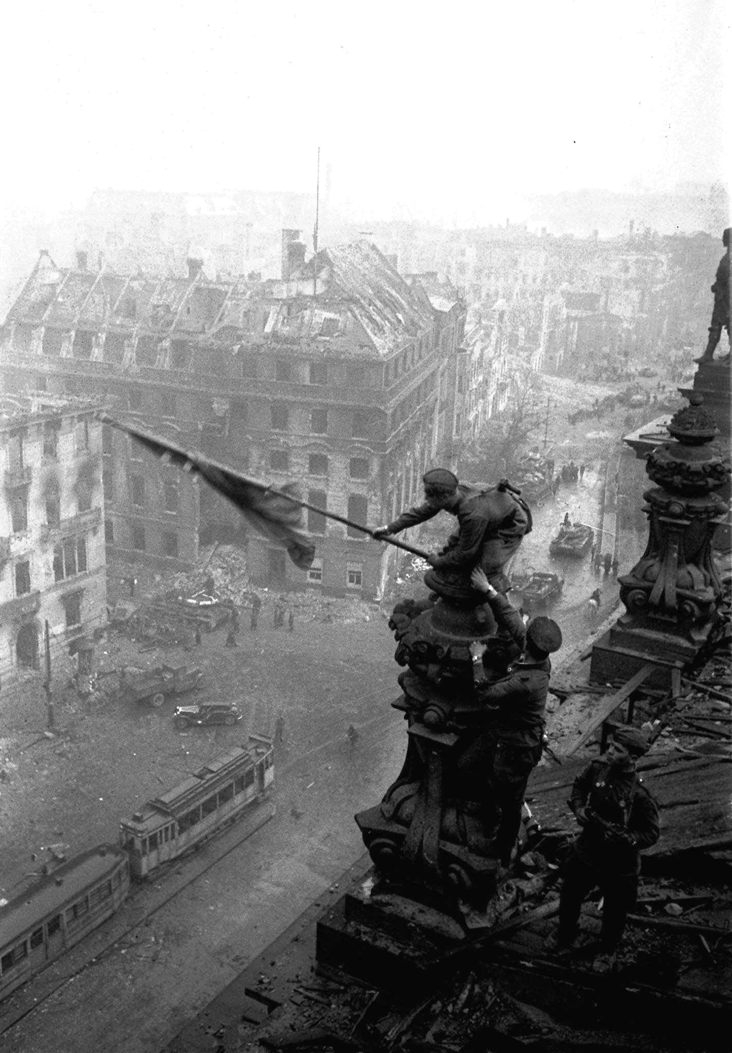 In this May 2, 1945 file photo, Soviet soldiers hoist the red flag over the Reichstag in Berlin. It's one of the iconic images of World War II: Soviet soldiers hoisting a red flag on top of the Reichstag after the fall of Berlin. What most people don't realize, however, is that the photograph isn't capturing the historical moment. Yevgeni Khaldei staged the scene on May 2, 1945 _ three days after the Soviets had captured the key seat of Nazi power.