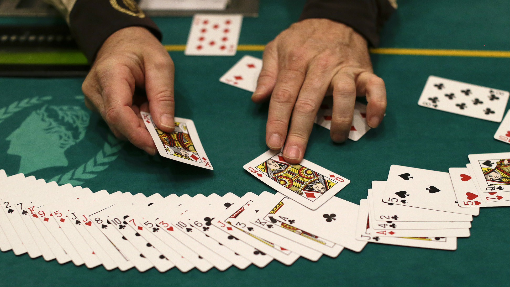 Jeff Martos resets a deck of cards during a break in poker play at Caesar's Palace, Wednesday, Feb. 27, 2013, in Las Vegas.