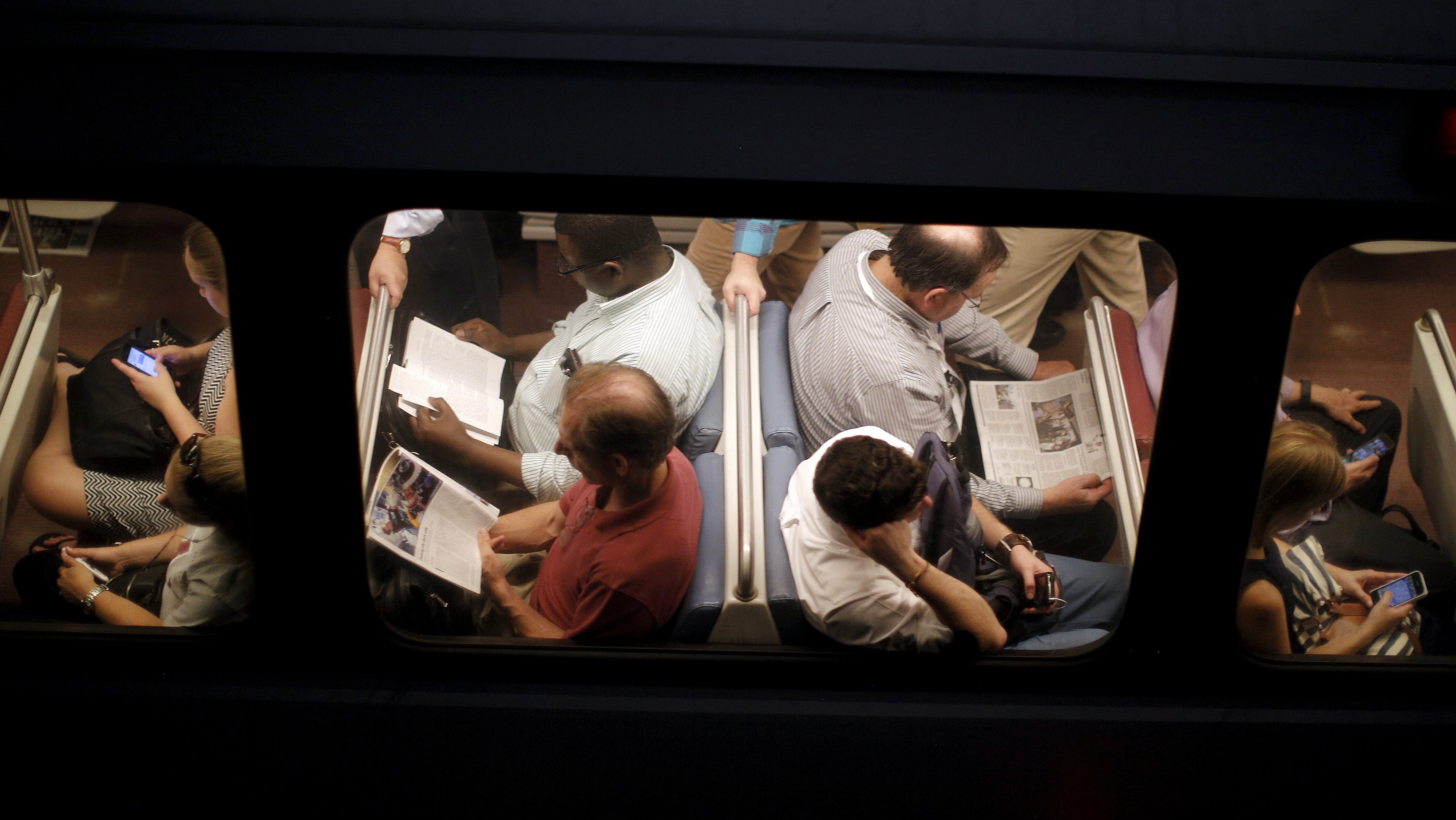 Commuters travel on a metro line at the Washington metro area