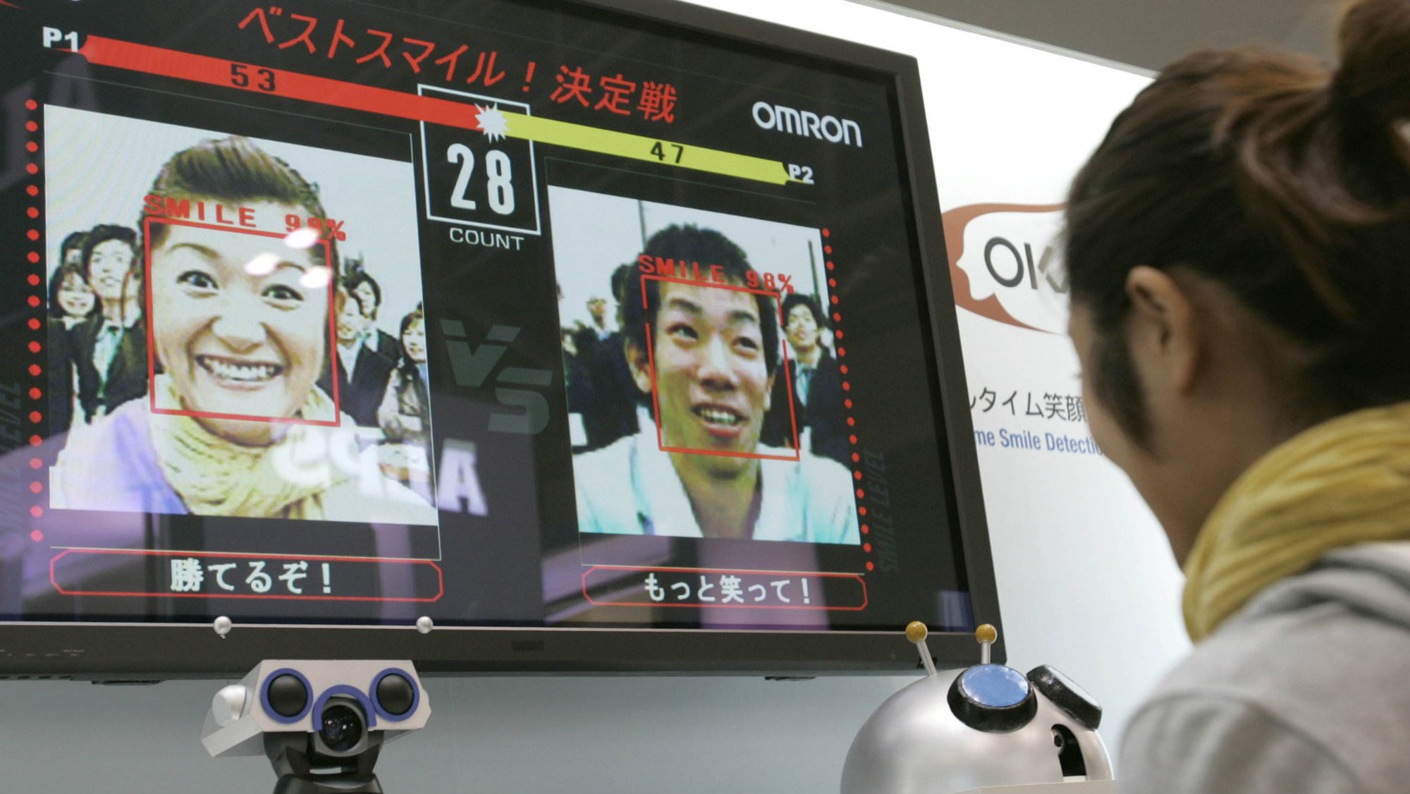 Visitors at the CEATEC technology trade show compete in a 2007 smiling contest judged by face-recognition in Japan.