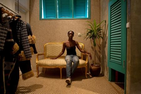 Fashion designer Loza Maleombho sits in the showroom of her clothing line in Abidjan.