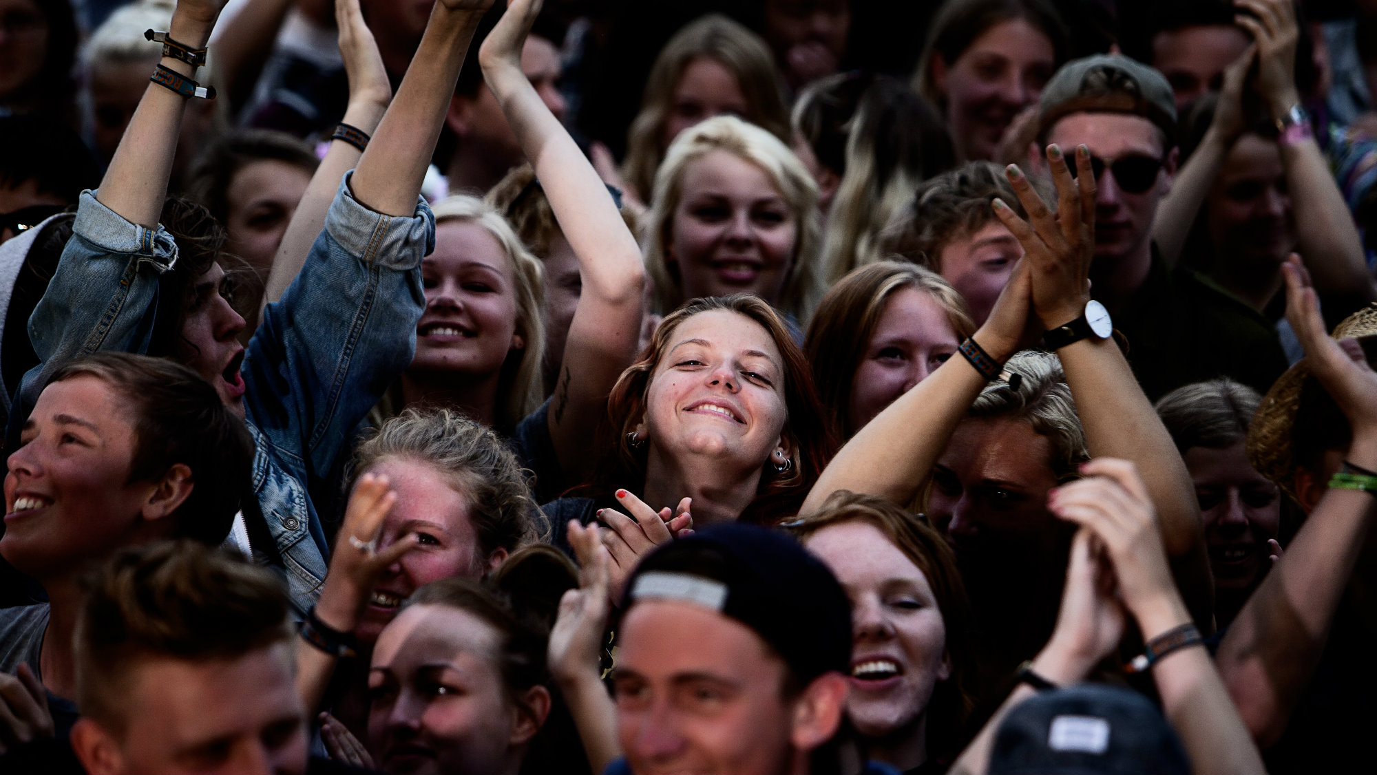Festival goers dance as they attend a concert by Danish singer Vinnie Who during the official opening of the Roskilde music festival 2013 in Roskilde, Denmark
