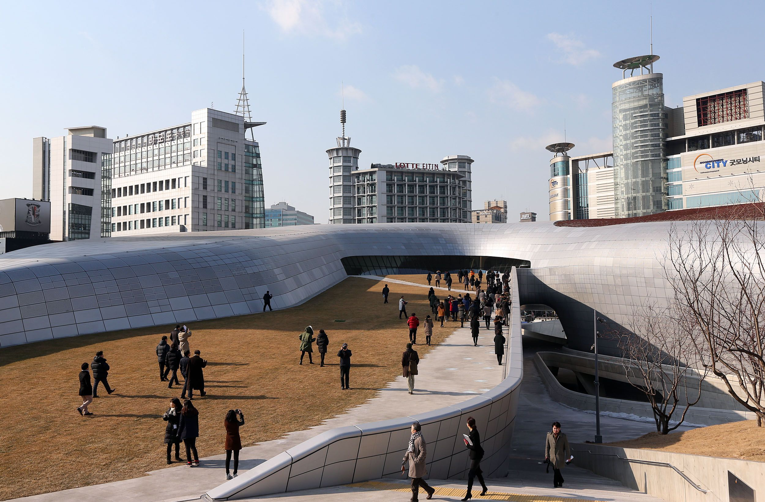 A group of reporters are seen visiting the exterior of the Dongdaemun Design Plaza during a press preview in Seoul, South Korea