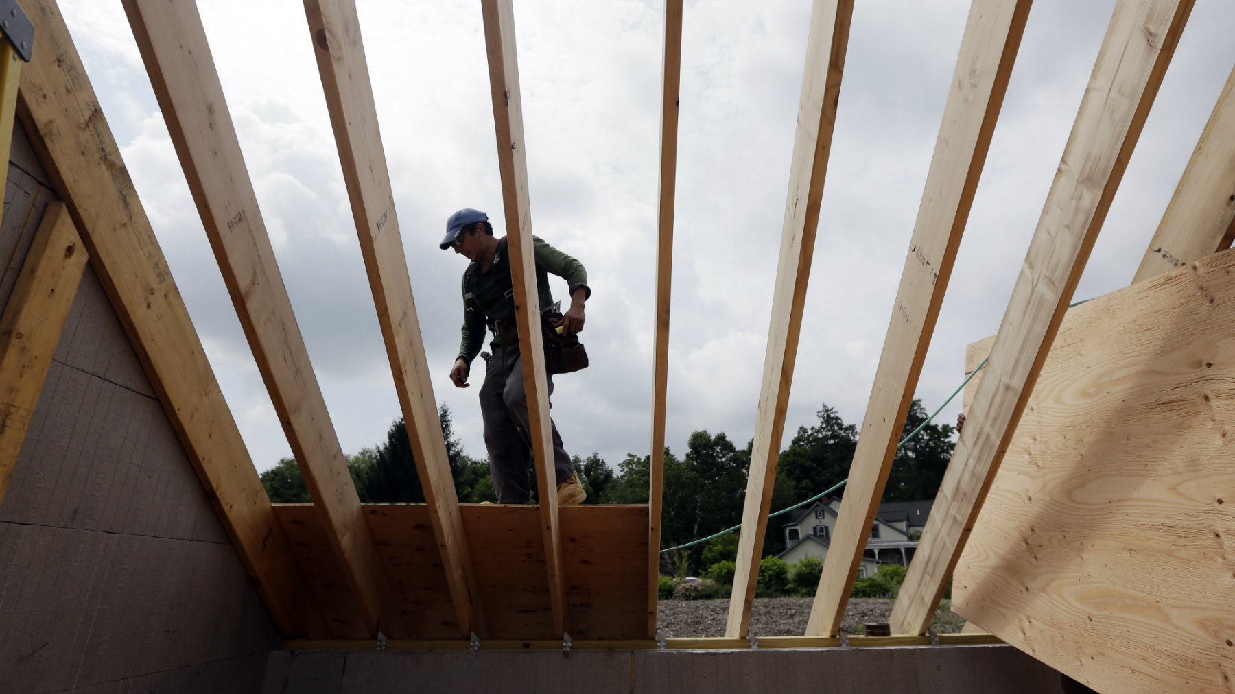 A worker installs a roof on a home in New Paltz, New York.