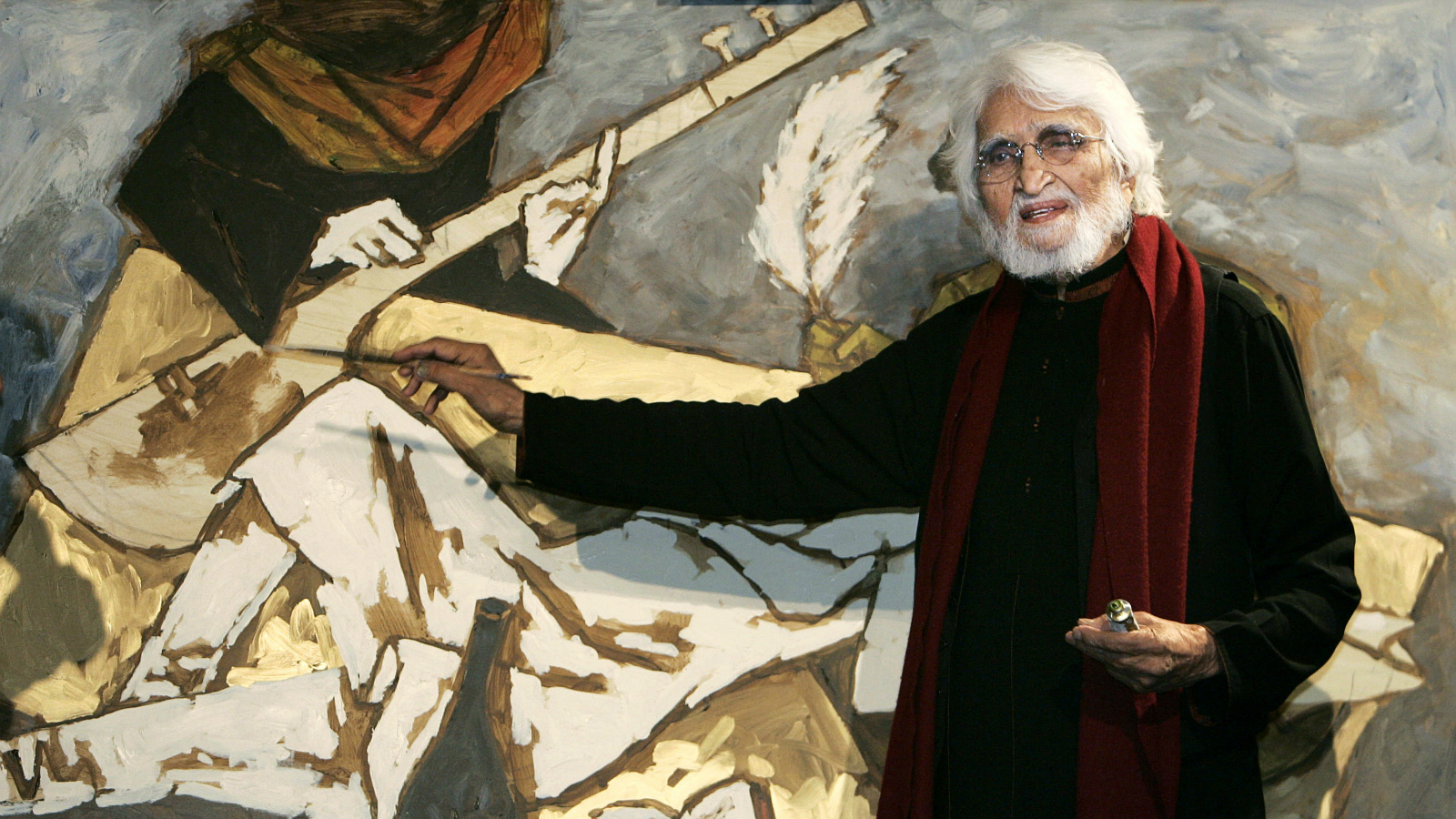 FILE - In this June 7, 2007 file photo, M.F. Husain, India's most famous artist, finishes off a canvas he painted together with Bollywood actor Shah Rukh Khan, unseen, during a fund-raising auction in central London's auction house. News reports say Hussain has died in London Thursday, June 9, 2011. Hussain had lived in self-imposed exile in Dubai since 2005 after coming under attack from Hindu hard-liners in India for a nude painting of a woman shaped like India's map. No details of the cause of his death were immediately known. (AP Photo/Lefteris Pitarakis, File)