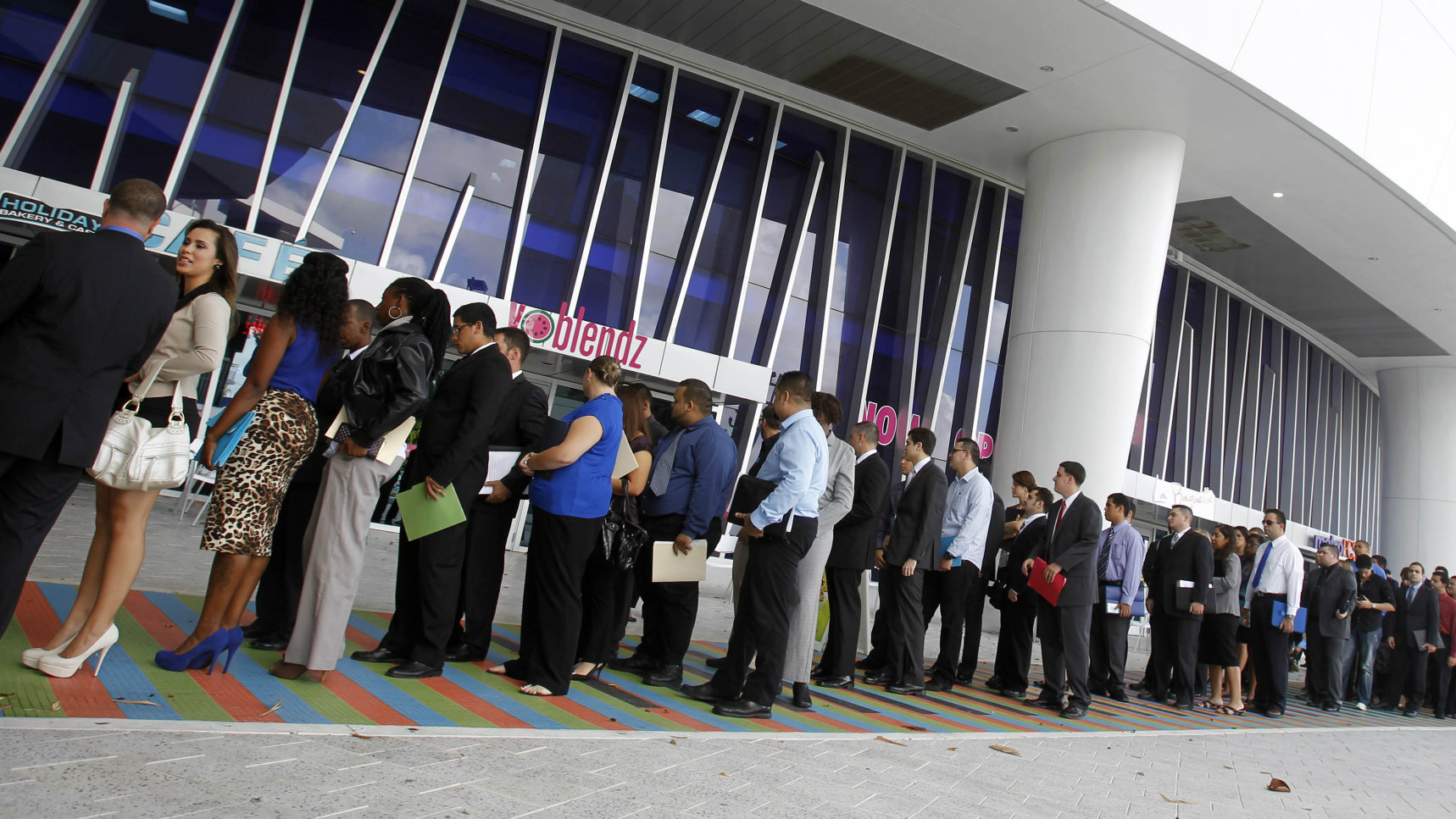 Job applicants stand in line at outside Marlins Park in Miami, Wednesday, Oct. 24, 2012 as the Florida Marlins host an Internship Job Fair to fill paid internship positions as the 2013 baseball season approaches.