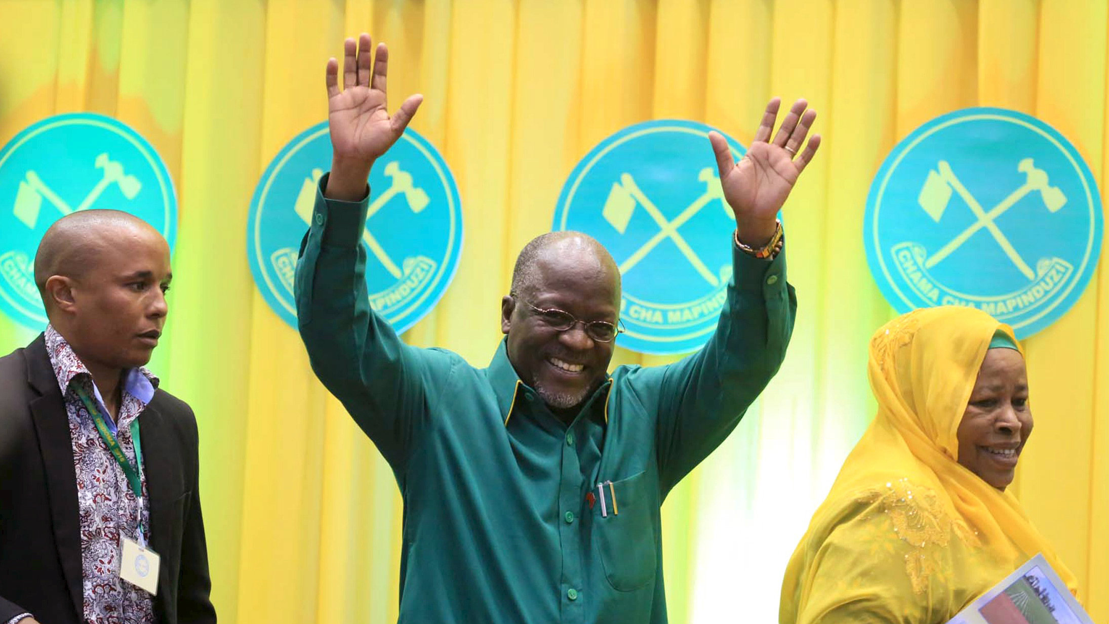 Tanzania's Works Minister John Magufuli (C) salutes delegates after the ruling party Chama Cha Mapinduzi (CCM) elected him as the presidential candidate for the October 25 election in the capital Dodoma, July 12, 2015.