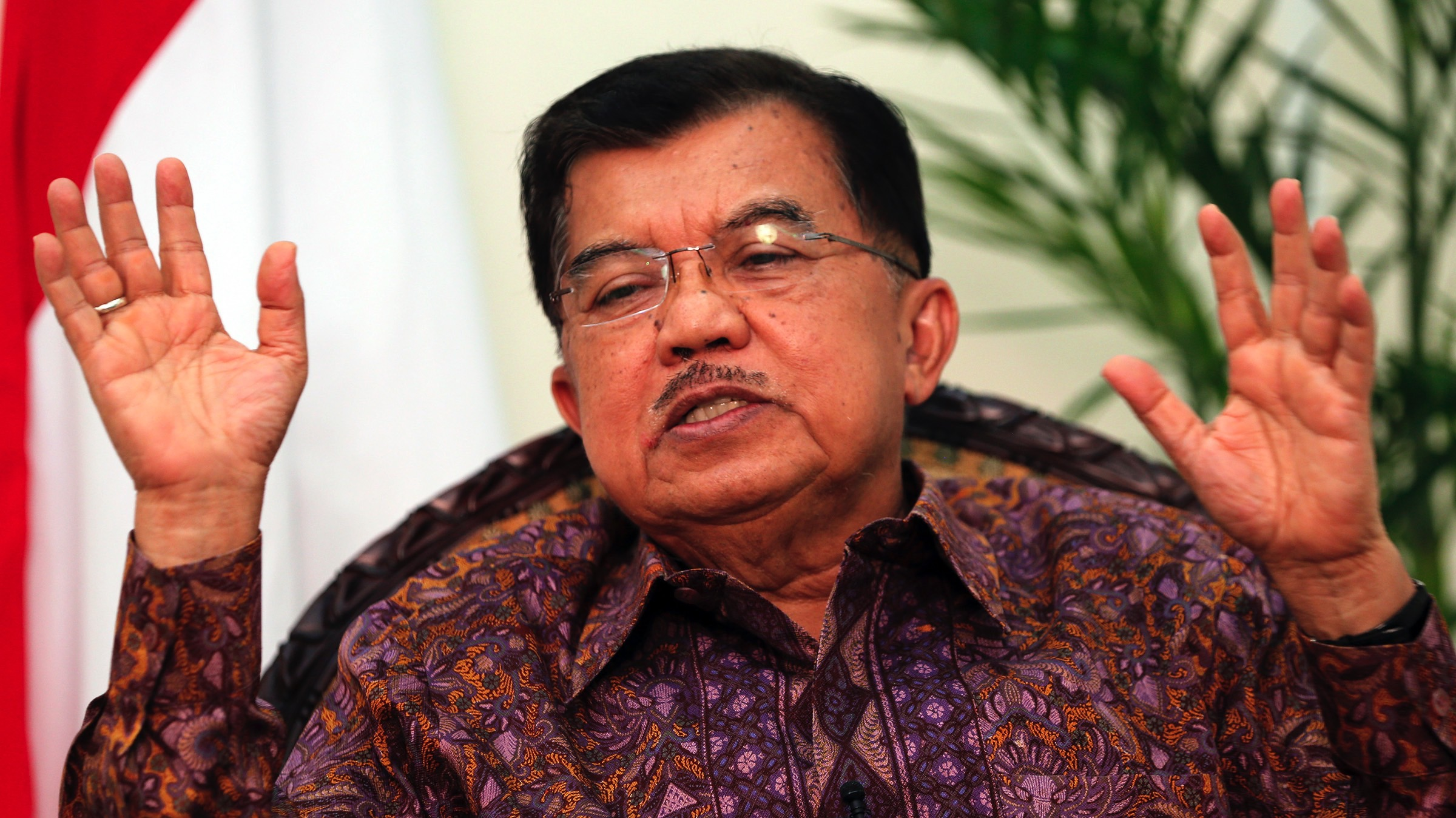 Indonesia's Vice President Jusuf Kalla gestures during an interview at the vice presidential palace in Jakarta