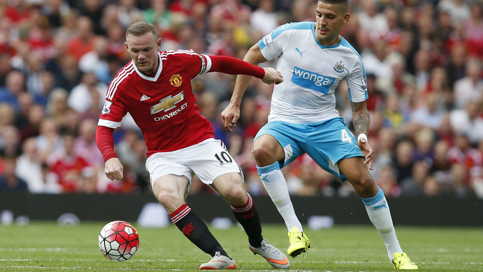 ootball - Manchester United v Newcastle United - Barclays Premier League - Old Trafford - 22/8/15 Manchester United's Wayne Rooney in action with Newcastle United's Aleksandar Mitrovic