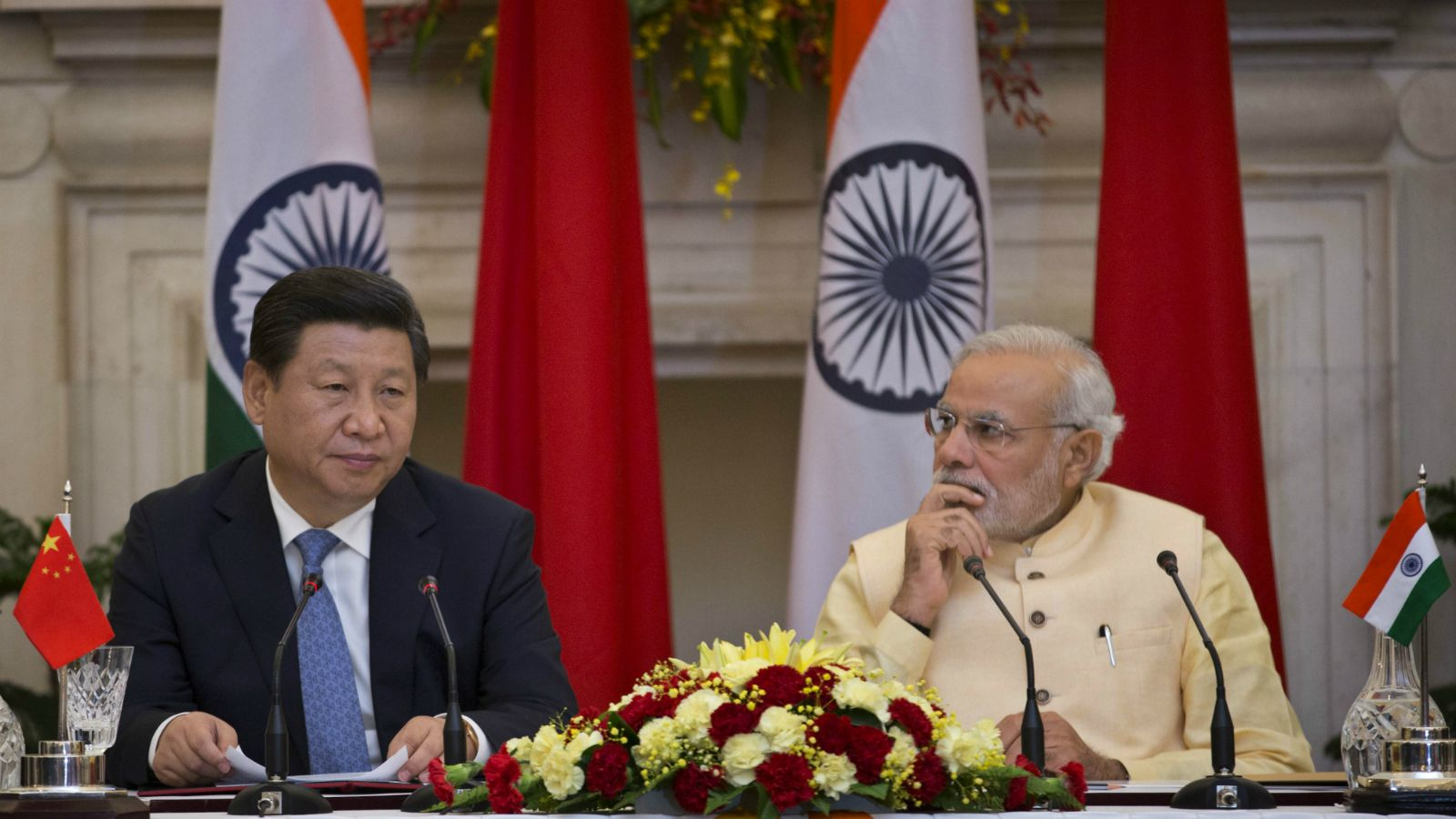 Chinese President Xi Jinping makes a statement before the media as Indian Prime Minister Narendra Modi, right watches after signing agreements in New Delhi, India, Thursday, Sept. 18, 2014. Xi vowed to bring prosperity to Asia and create opportunities for the world as he and Modi began talks Thursday to deepen cooperation through investment and trade.