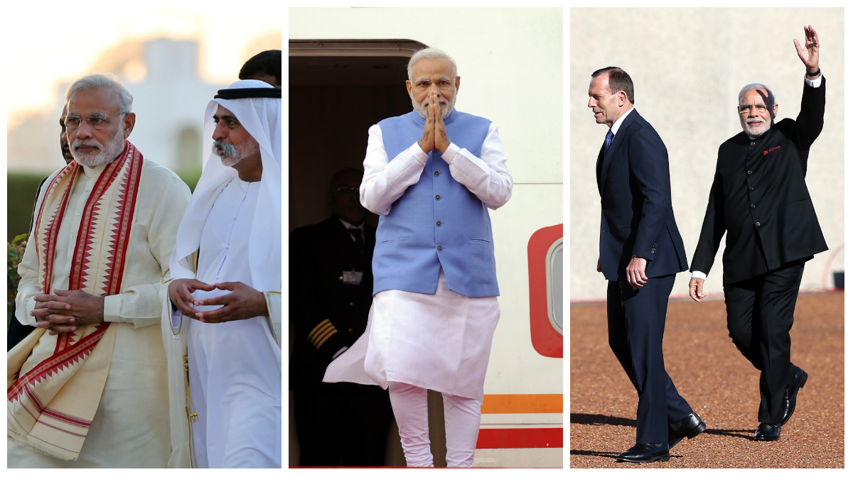 Indian Prime Minister Narendra Modi, left, walks with Sheikh Hamdan bin Mubarak Al Nahyan, UAE Minister of Higher Education and Scientific Research, during a visit to the Sheikh Zayed Grand Mosque during the first day of a two-day visit to the UAE, in Abu Dhabi, United Arab Emirates, Sunday, Aug. 16, 2015. The UAE is home to over two million Indian expatriates and this is the first visit by an Indian premier in over three decades. (AP Photo/Kamran Jebreili)  India's Prime Minister Narendra Modi gestures from the steps of his plane as he arrives at the airport on Mauritius Island, in the Republic of Mauritius, Wednesday, March 11, 2015. According to the Indian Prime Minister's website Modi is leading a delegation on a three nation tour of Seychelles, Mauritius and Sri Lanka to strengthen ties between the countries. (AP Photo/George Michel)  India's Prime Minster Narendra Modi, right, waves to onlookers as he walks with Australian Prime Minister Tony Abbott during a ceremonial welcome in Canberra, Tuesday, Nov. 18, 2014. Modi is having bilateral talks with Australia following on from the G20 summit. (AP Photo/Rick Rycroft)