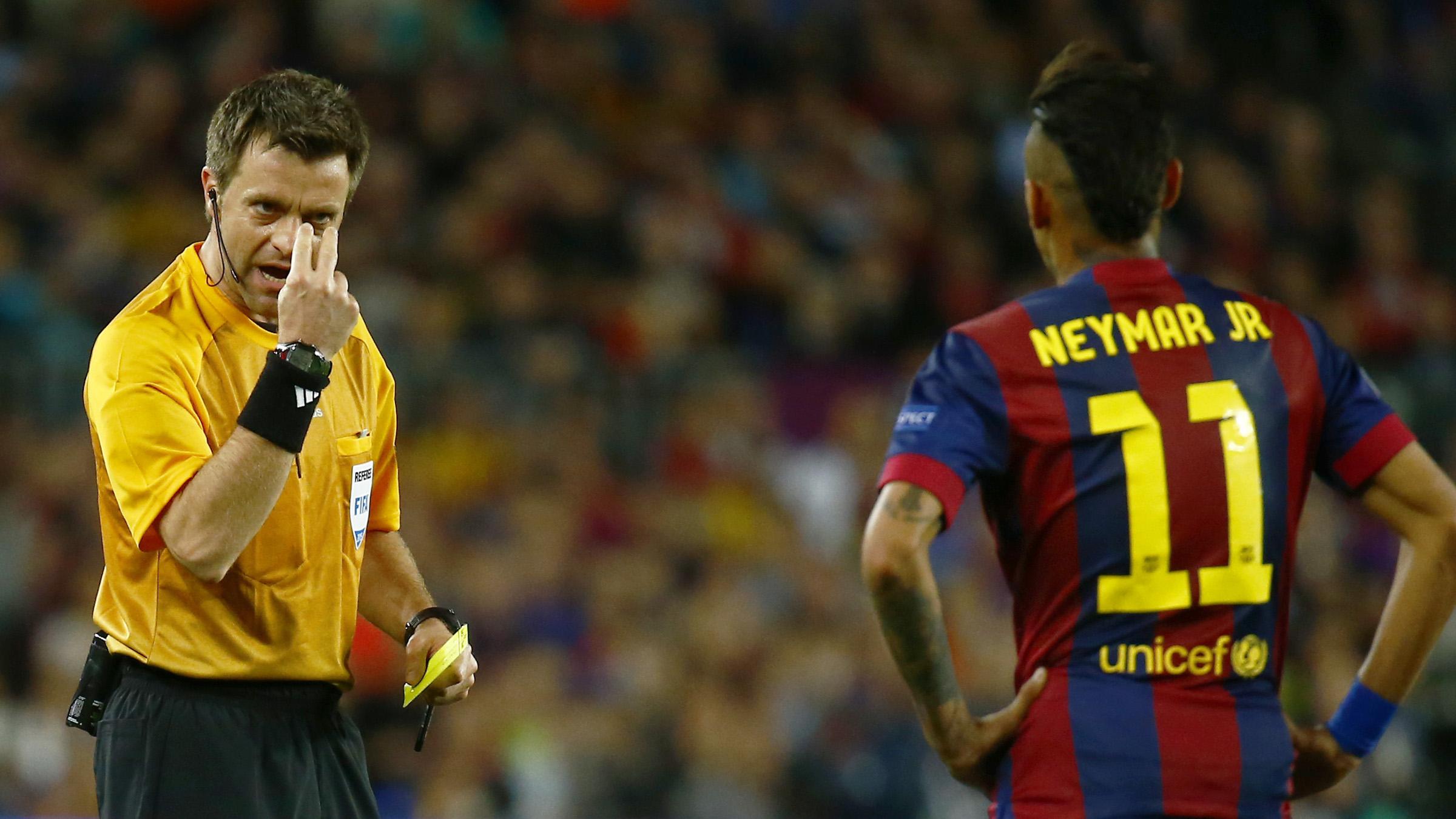 Barcelona's Neymar is shown a yellow card by referee Nicola Rizzoli