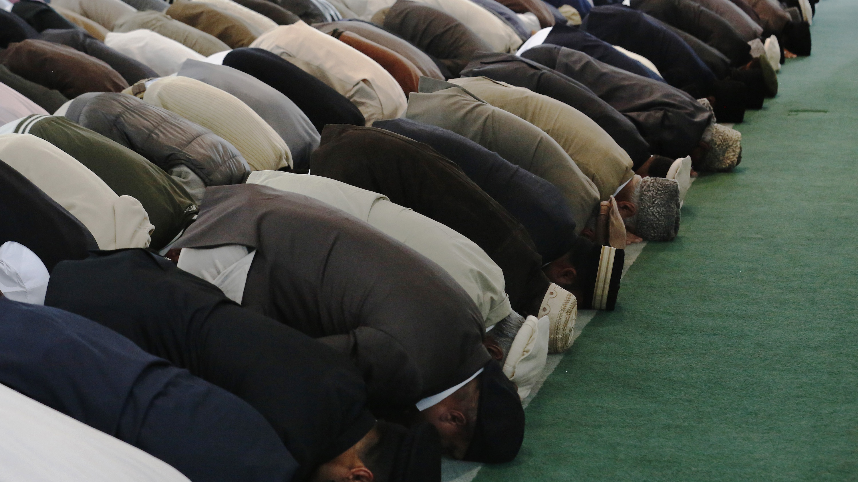 Men pray at the Baitul Futuh Mosque in Morden, south London.