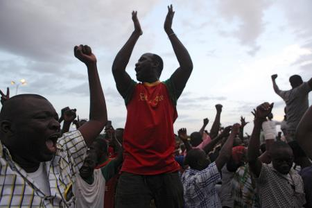 """Protesters chanted, """"Release the hostages"""" outside the presidential palace."""