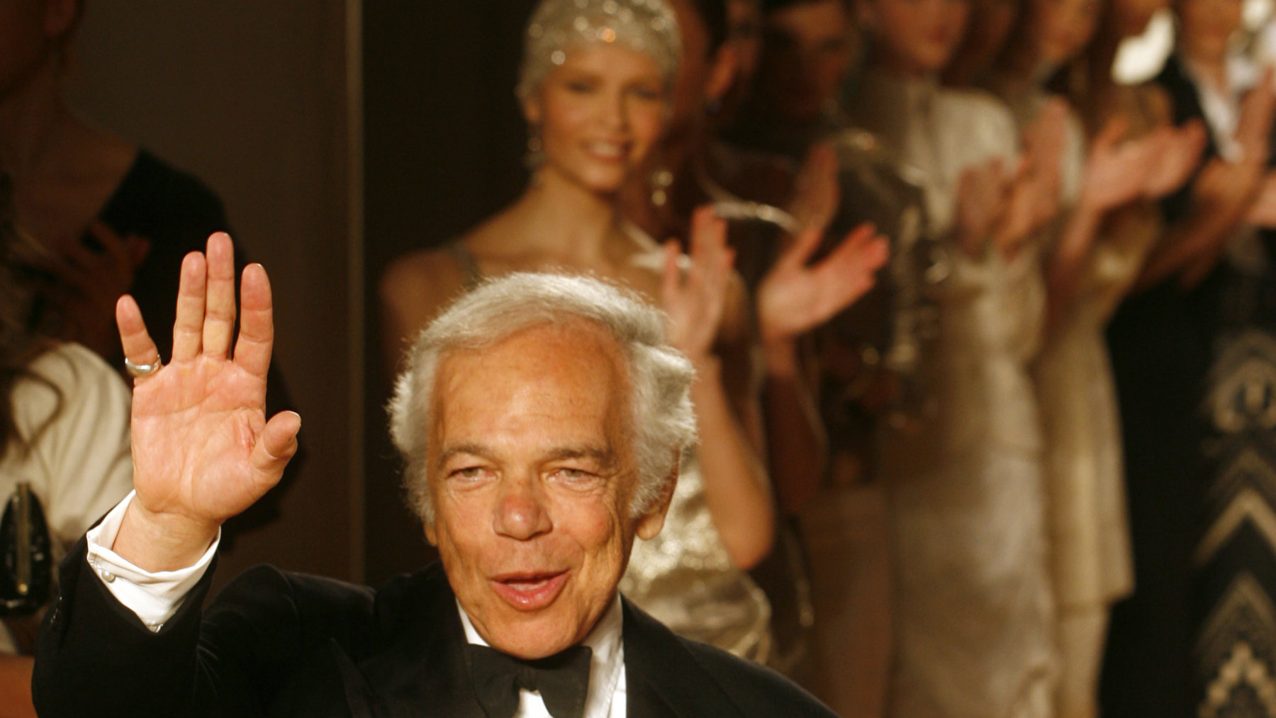 American designer Ralph Lauren acknowledges greetings after his fashion show in the Spaso House, U.S. Ambassador's residence in Moscow, Tuesday, May 15, 2007. (AP Photo/Mikhail Metzel)