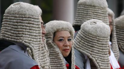 Judges wearing wigs attend a ceremony to mark the beginning of the new legal year in Hong Kong.