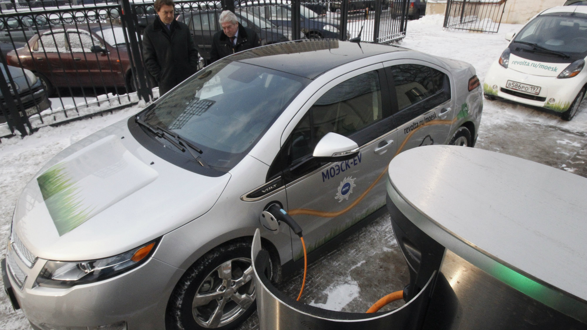 An electric car is charged during a demonstration ceremony to launch a charging station owned by the Moscow United Electric Grid Company (MOESK), in Moscow.