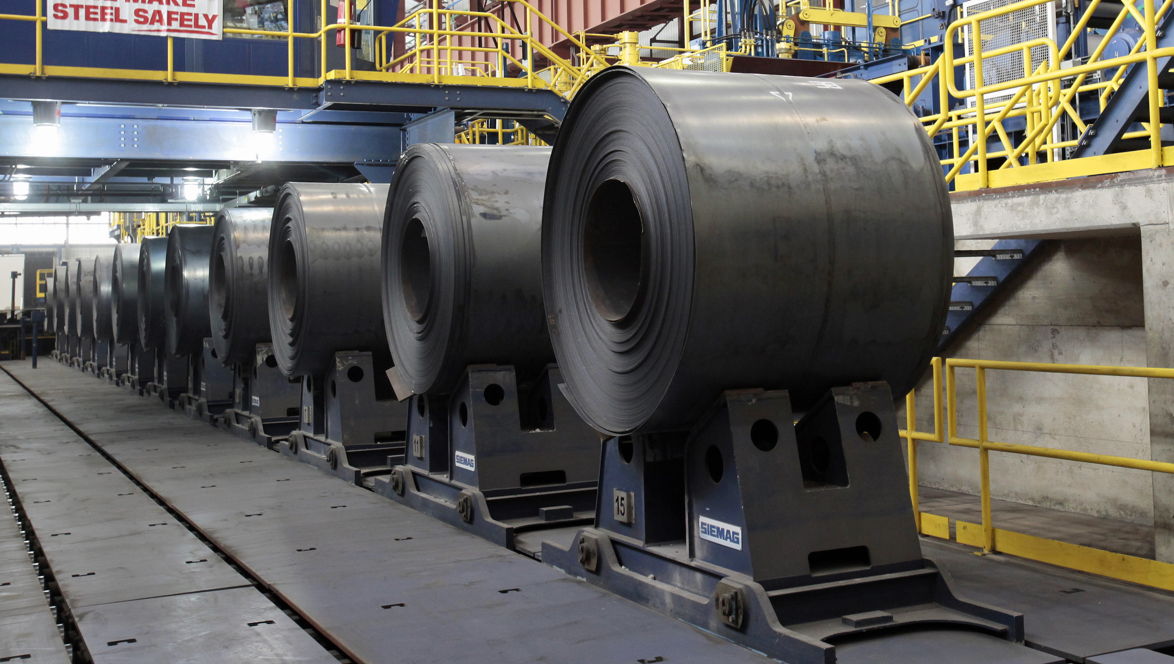 Rolled steel is seen after being treated on the pickle line at the Severstal steel mill in Dearborn, Michigan June 21, 2012. Russian steel company Severstal has no plans to expand its U.S. manufacturing footprint at this time, Chief Executive Alexey Mordashov said on Thursday. REUTERS/Rebecca Cook (UNITED STATES - Tags: BUSINESS) - RTR33ZER