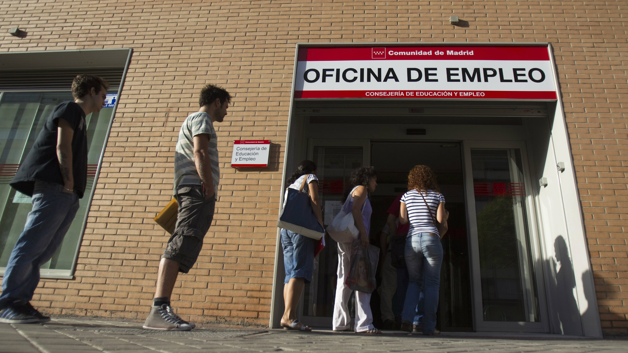 People enter a government-run employment office in Madrid.