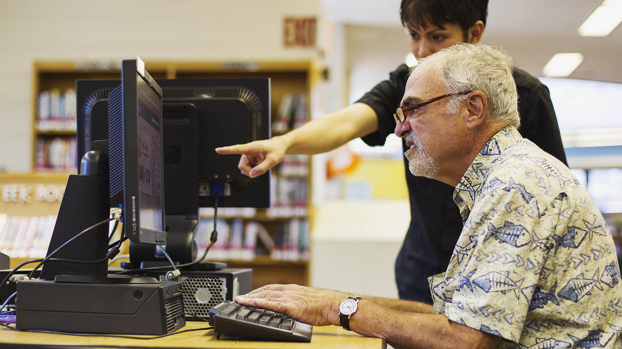 Librarian Bertrand Bobis  (L) teaches a senior citizen how to use a Facebook account during a class at a branch of the New York Public Library in New York August 13, 2012. Seniors, some in their 90s, could soon be making new friends on Facebook thanks to New York libraries offering classes to help the elderly learn, or brush up their social network skills.