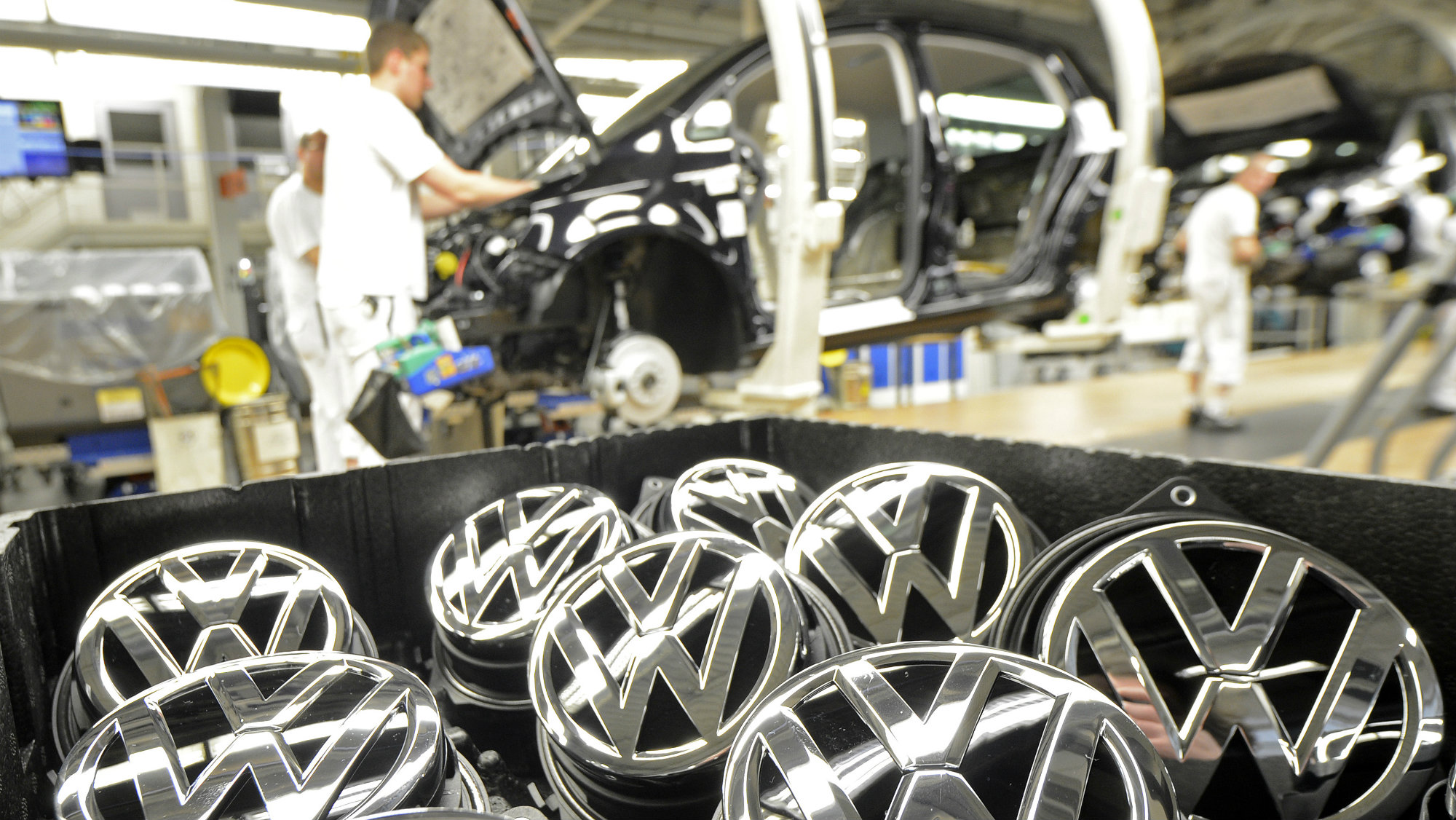 Emblems of VW Golf VII car are pictured in a production line at the plant of German carmaker Volkswagen in Wolfsburg.