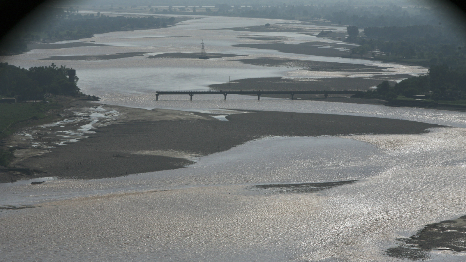 An aerial view taken from the Indian Air Force's helicopter shows a damaged bridge which was swept away by floods on the river Tawi in the outskirts of Jammu September 7, 2014. The death toll from serious flooding in Indian-administered Kashmir climbed to 175 on Sunday, with homes, military bases and hospitals inundated in the region's main city Srinagar as the Jhelum river overflowed its banks. About 22 air force helicopters and four aircraft were deployed to evacuate stranded people and to deliver relief.