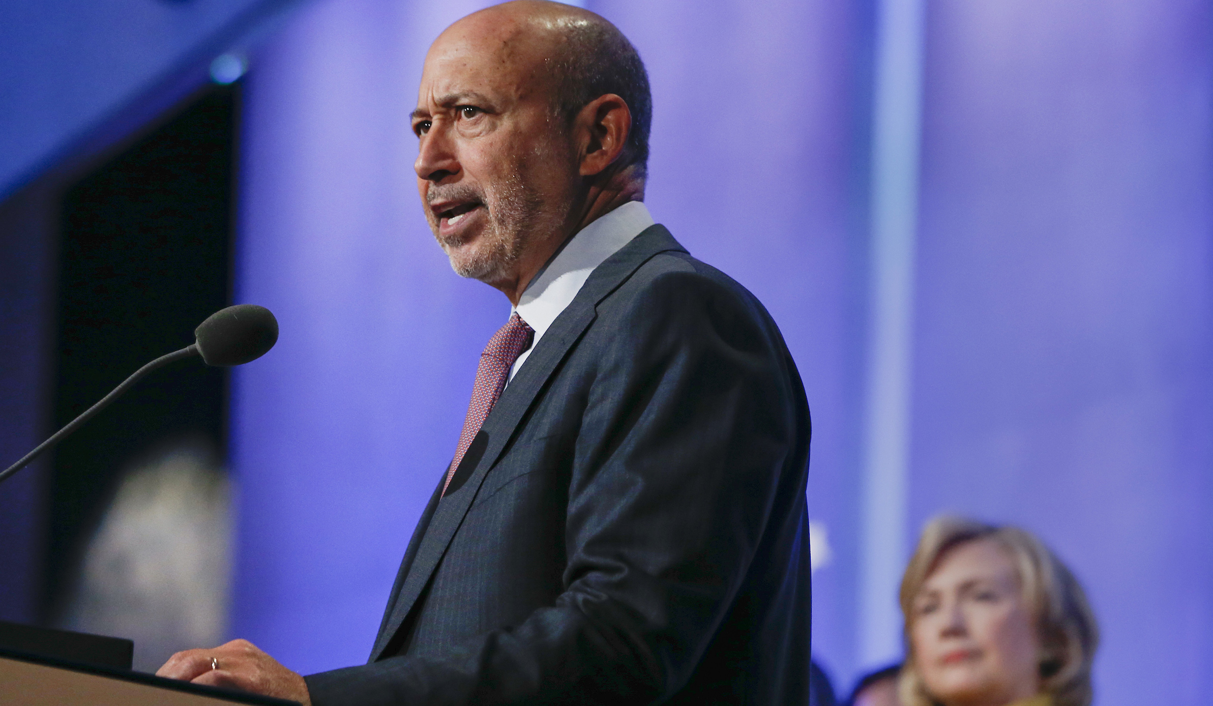 """Goldman Sachs Group Inc. Chairman and Chief Executive Officer Lloyd Blankfein speak as former U.S. Secretary of State Hillary Clinton (L) listens during the plenary session titled """"Equality for Girls and Women: 2034 Instead of 2134?"""" at the Clinton Global Initiative 2014 (CGI) in New York, September 24, 2014. The CGI was created by former U.S. President Bill Clinton in 2005 to gather global leaders to discuss solutions to the world's problems. REUTERS/Shannon Stapleton (UNITED STATES - Tags: POLITICS SOCIETY BUSINESS) - RTR47J6X"""