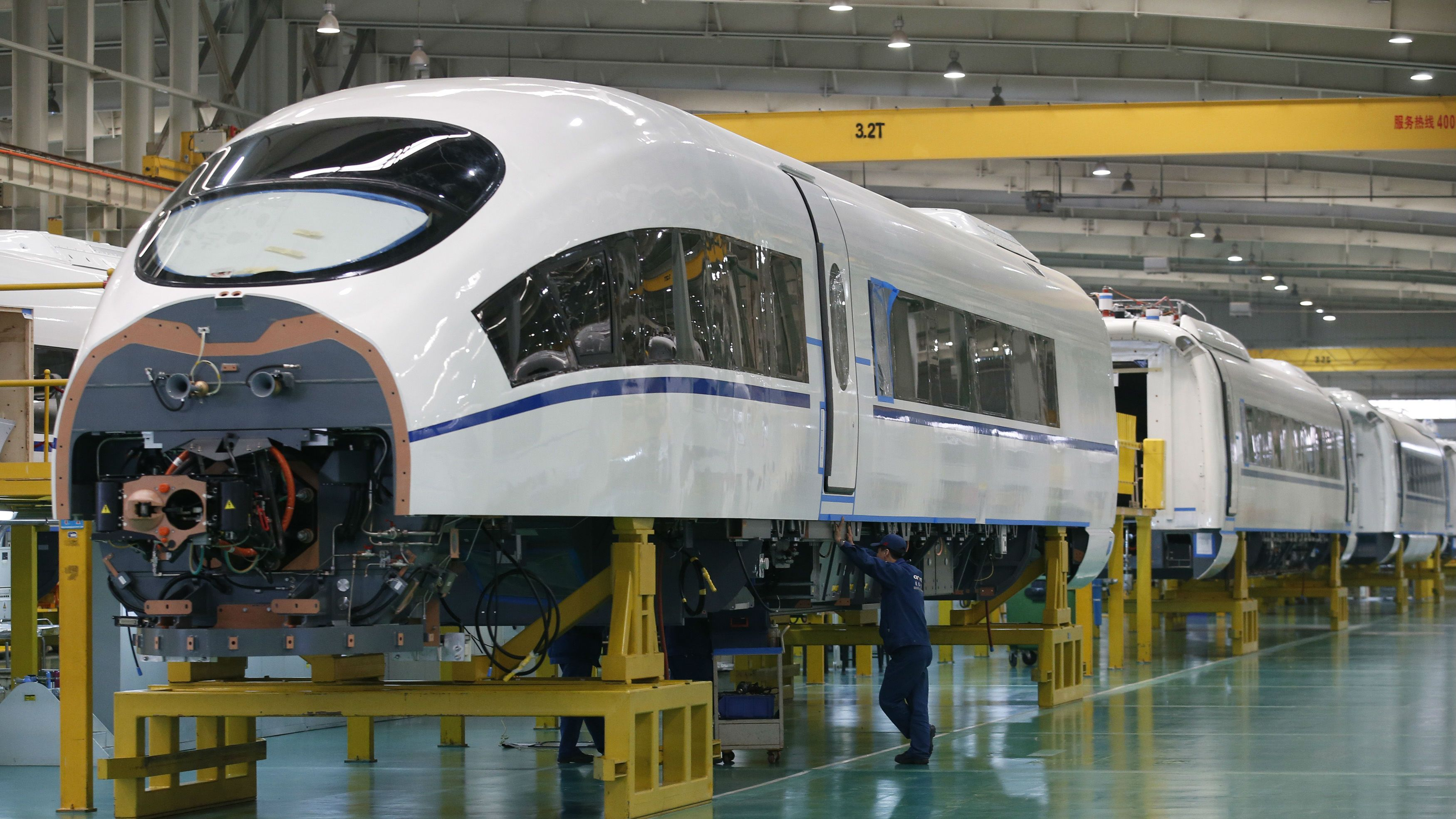 An employee works on a final assembly line for CRH380B, a high speed train model, at China CNR's Tangshan Railway Vehicle's factory in Tangshan, Hebei province, February 11, 2015. China CNR, one of the country's top trainmakers, said it was interested in buying foreign rail-linked technologies as China seeks to export its high-speed trains and rail expertise. REUTERS/Kim Kyung-Hoon (CHINA - Tags: SCIENCE TECHNOLOGY BUSINESS TRANSPORT)