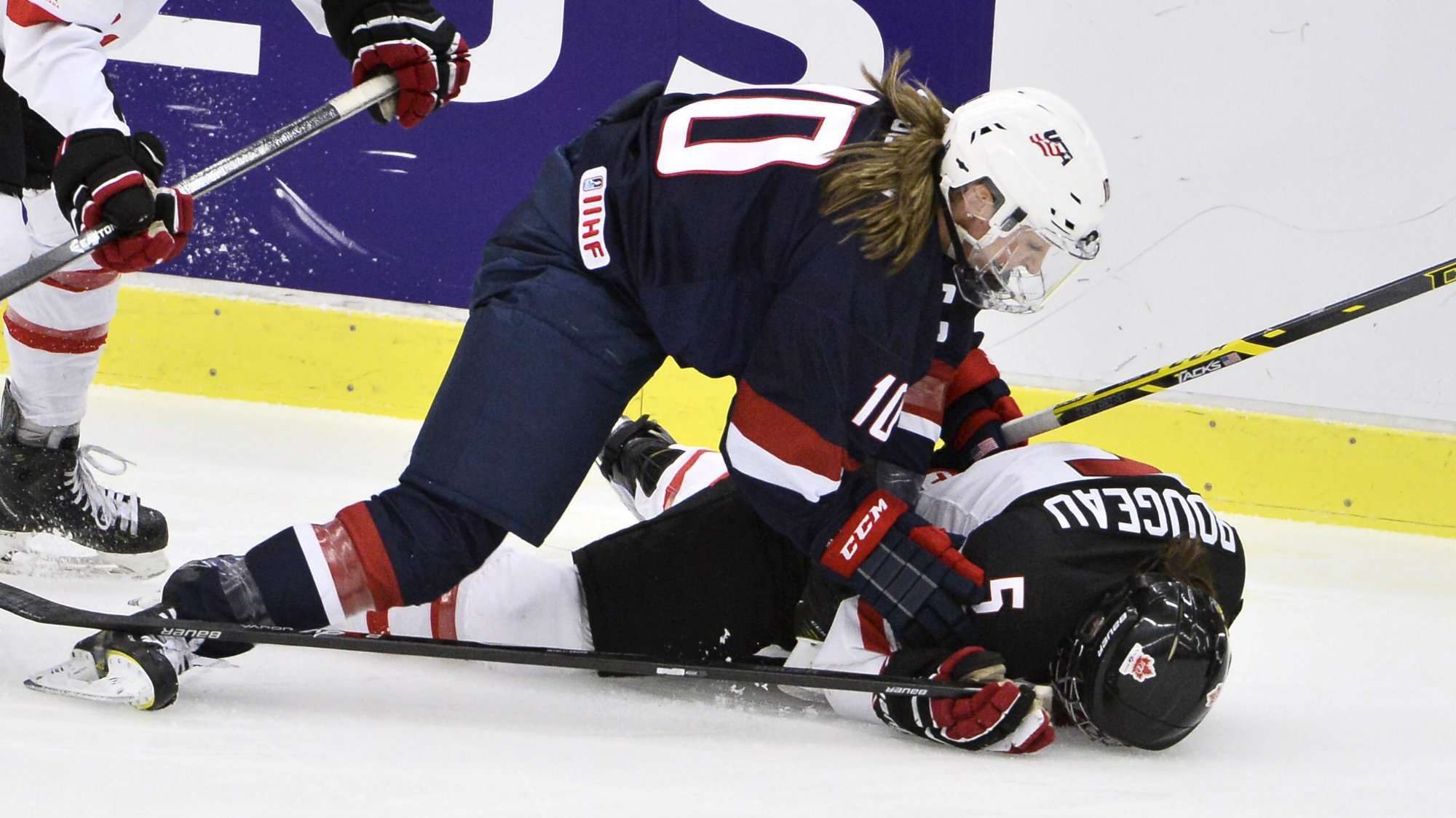 Megan Duggan of the U.S. fights for the puck with Canada's Lauriane Rougeau on the ice during the 2015...