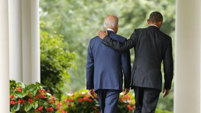 U.S. President Barack Obama (R) and Vice President Joe Biden walk back to the Oval Office after speaking about the Supreme Court ruling to uphold the nationwide availability of tax subsidies that are crucial to the implementation of the Affordable Care Act, at the White House in Washington June 25, 2015.
