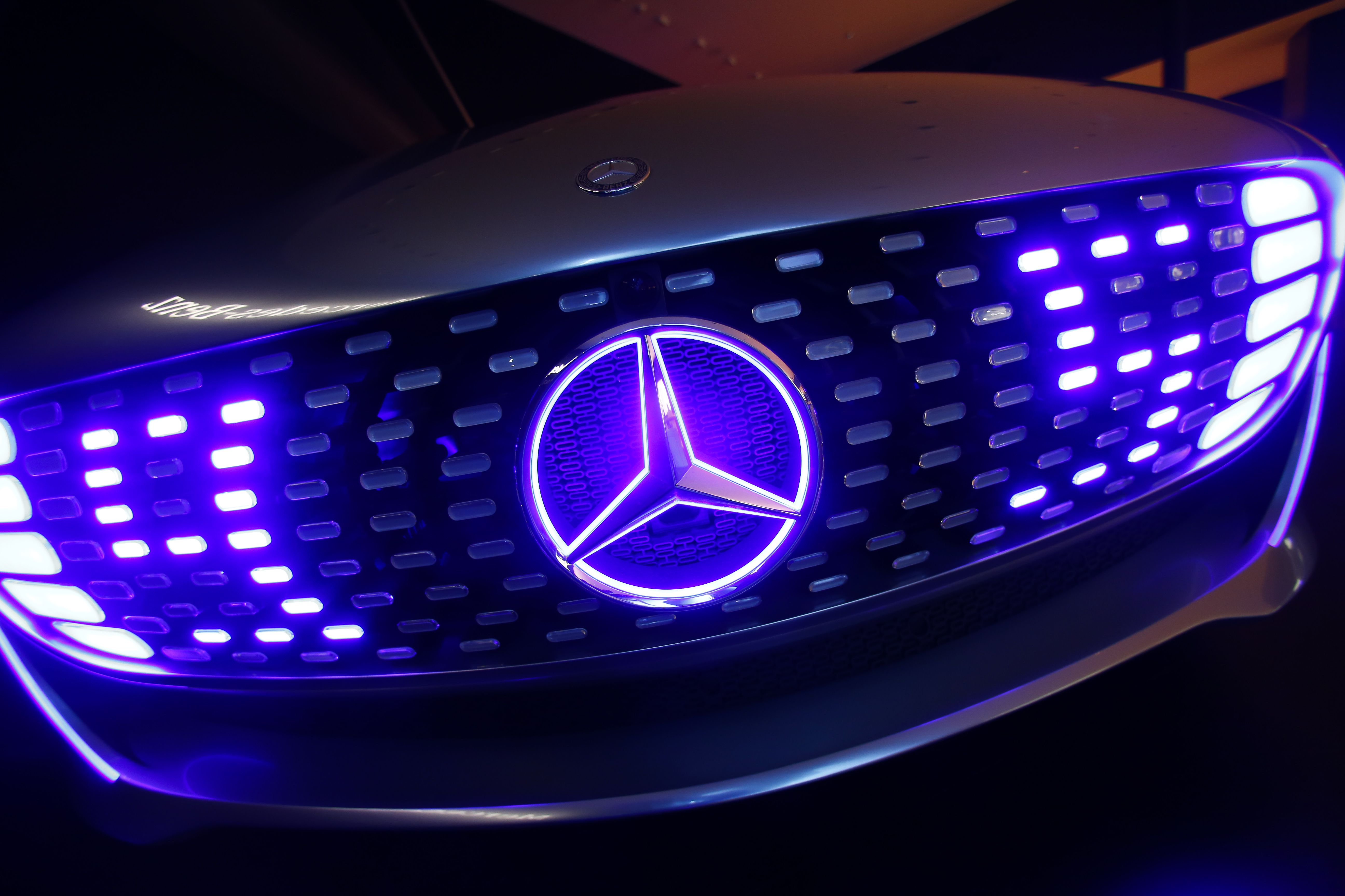 The front of a Mercedes-Benz F 015 Luxury in Motion concept car is pictured at the booth of Mercedes-Benz during the media day at the Frankfurt Motor Show (IAA) in Frankfurt, Germany, September 14, 2015. Flush with cash and confidence after years of rising sales, German carmakers are used to reaping industry-leading returns. But with Chinese demand abruptly slowing, the profit engine has begun to sputter, overshadowing the glitz of the world's biggest auto show which opens in Frankfurt.   REUTERS/Ralph Orlowski  - RTS10HH