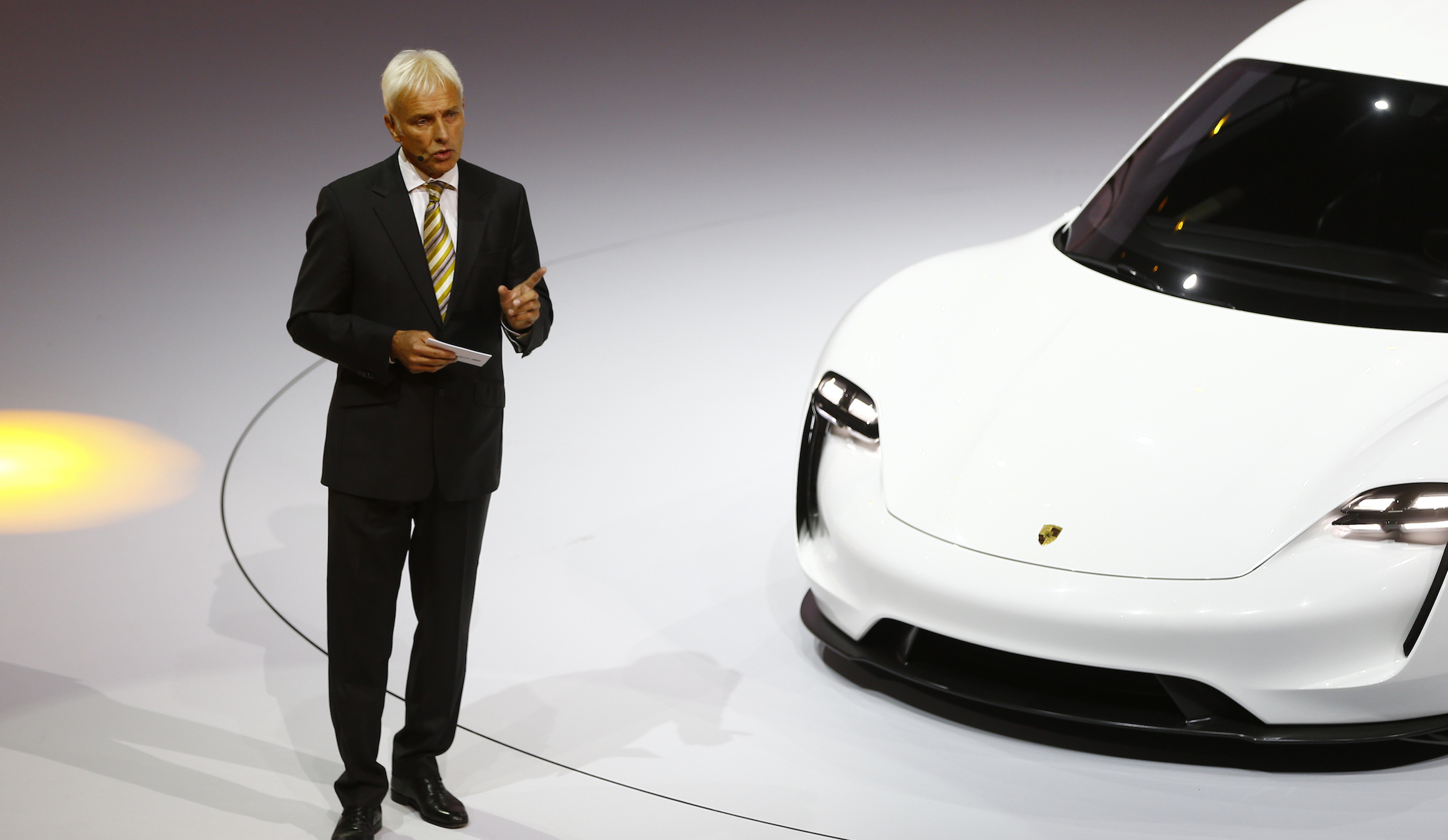 Porsche CEO Matthias Mueller presents the new electric Porsche Mission E concept car during the Volkswagen group night ahead of the Frankfurt Motor Show (IAA) in Frankfurt, Germany, September 14, 2015.     REUTERS/Kai Pfaffenbach   - RTS134L