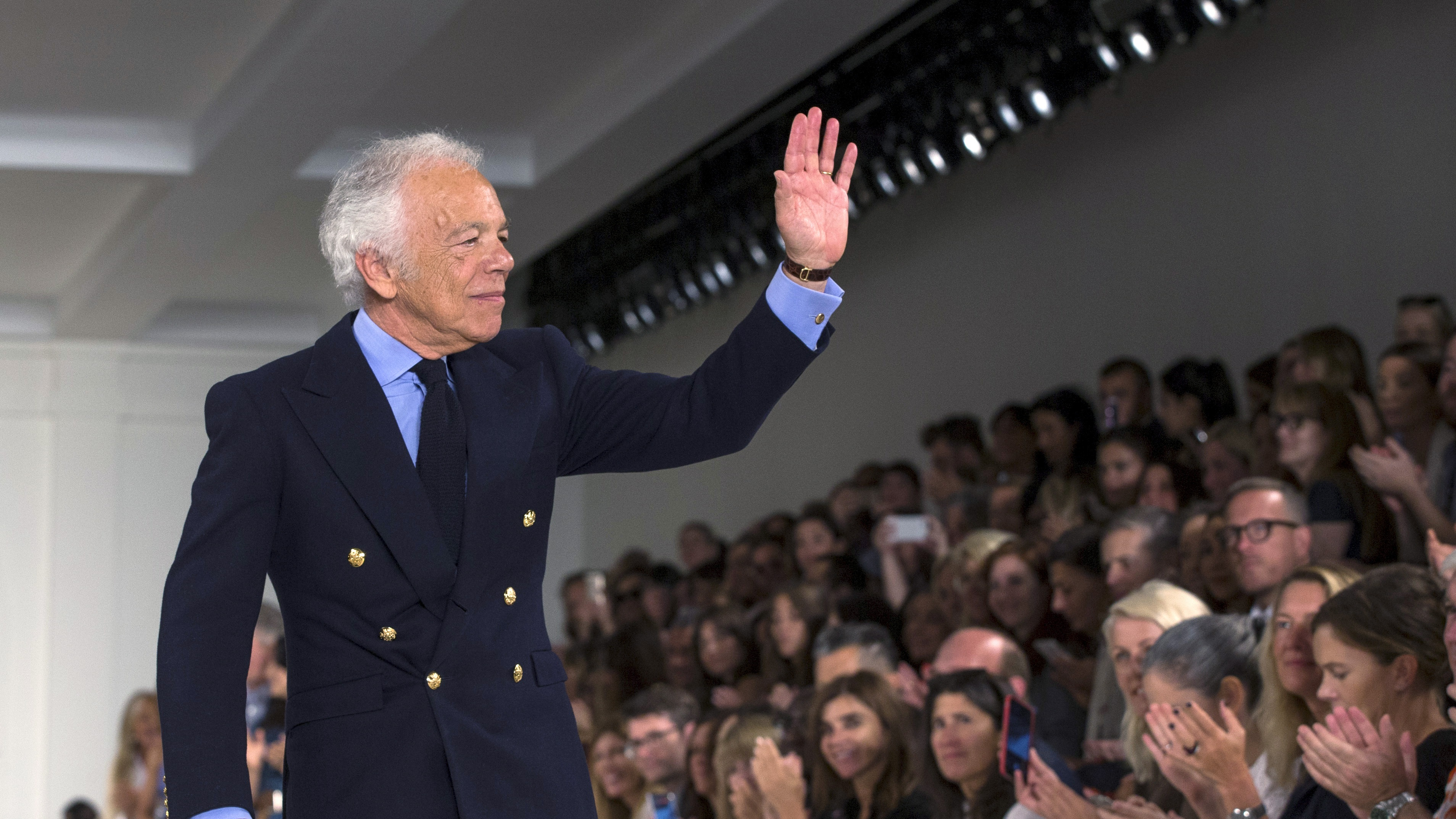 Designer Ralph Lauren greets the crowd after presenting his Spring/Summer 2016 collection during New York Fashion Week in New York, September 17, 2015.