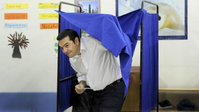 Former Greek prime minister and leader of leftist Syriza party Alexis Tsipras holds his ballot as he exits a voting booth during the general election at a polling station in Athens, Greece, September 20, 2015.