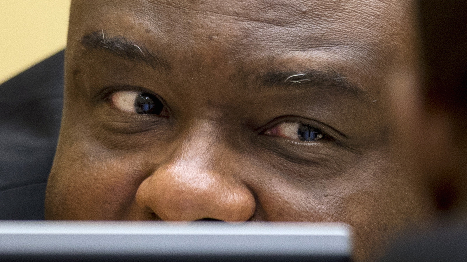 Former Congo vice-president Jean-Pierre Bemba looks up when sitting in the courtroom of the ICC in The Hague