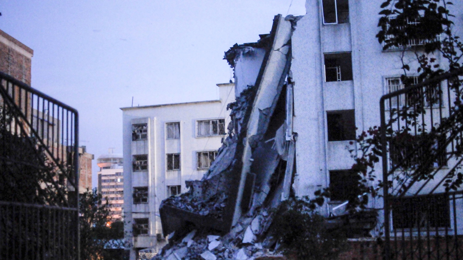 A damaged building is seen after explosions hit Liucheng county, Guangxi Zhuang Autonomous Region, China, September 30, 2015. A series of package bombs exploded on Wednesday in China's southwestern city of Liuzhou, killing at least three people, state television said, publishing images of a collapsed building, a plume of smoke and streets strewn with rubble.