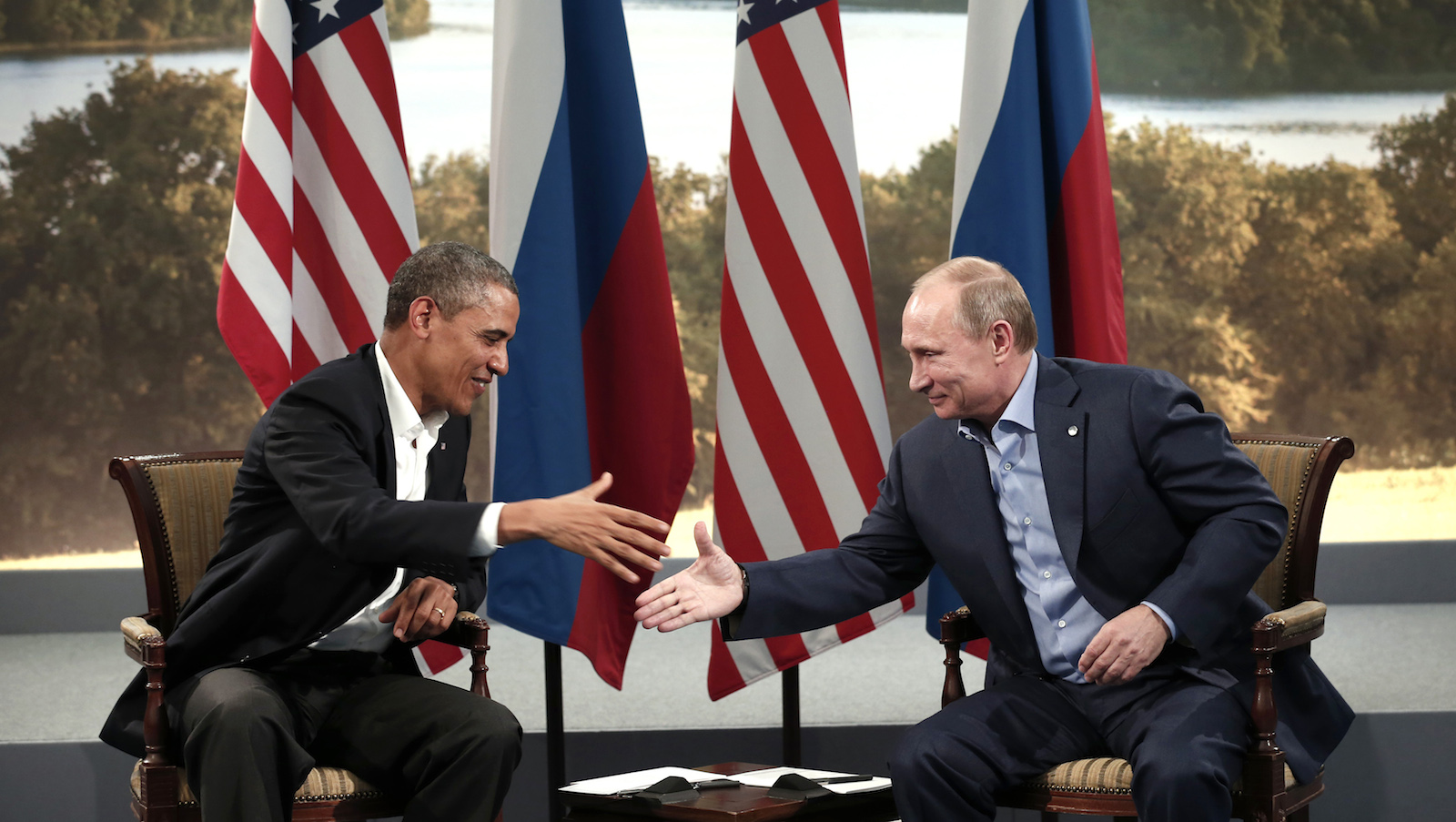 U.S. President Barack Obama and Russian President Vladimir Putin shake hands during their meeting at the G8 Summit at Lough Erne in Enniskillen, Northern Ireland June 17, 2013. REUTERS/Kevin Lamarque (NORTHERN IRELAND - Tags: POLITICS) - RTX10R95