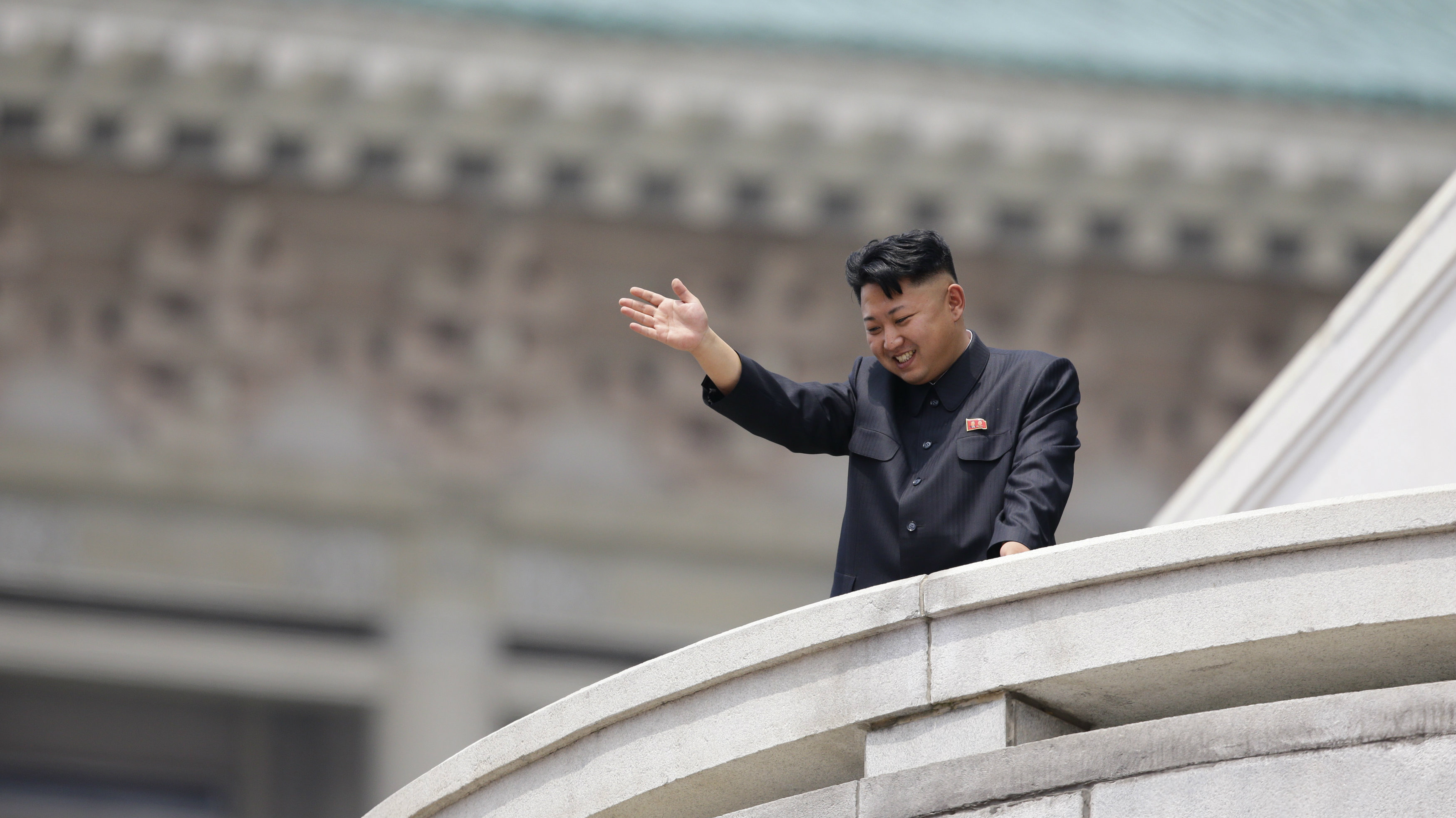 North Korean leader Kim Jong-un waves to the people during a parade in Pyongyang.
