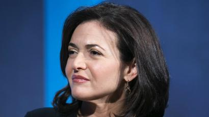 The chief operating officer of Facebook, Sheryl Sandberg, listens at the Clinton Global Initiative 2013.