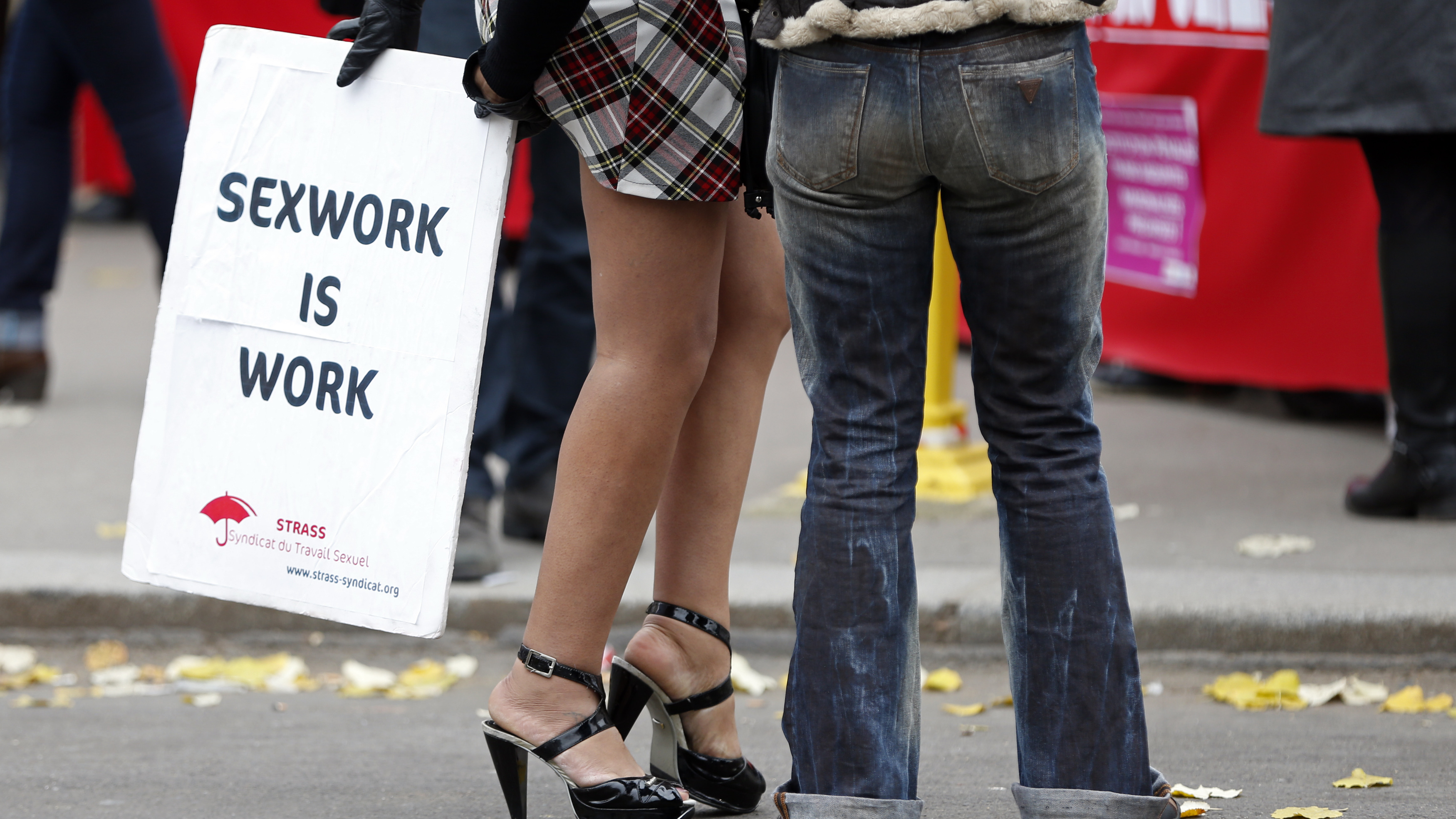 A sex worker activist attends a demonstration with prostitutes against a proposal to scrap sanctions on soliciting and instead punish prostitutes' customers with fines in Paris