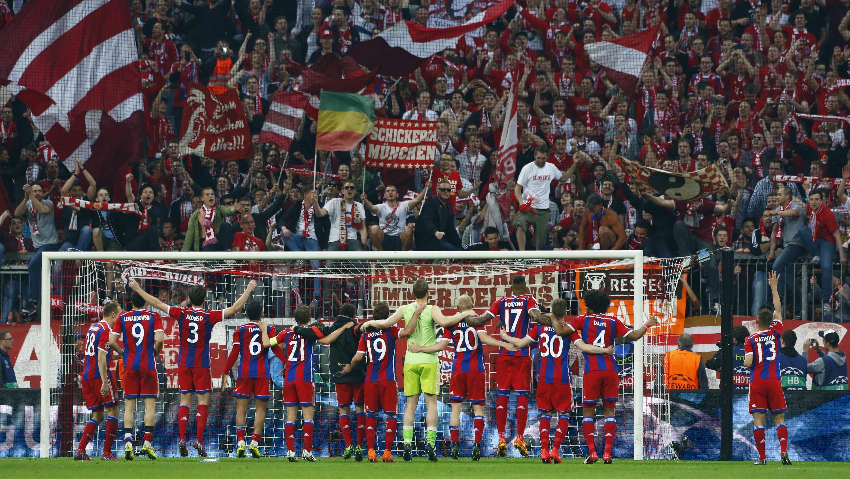 Football - Bayern Munich v Porto - UEFA Champions League Quarter Final Second Leg - Allianz Arena, Munich - Germany - 21/4/15 Bayern Munich players celebrate after the match