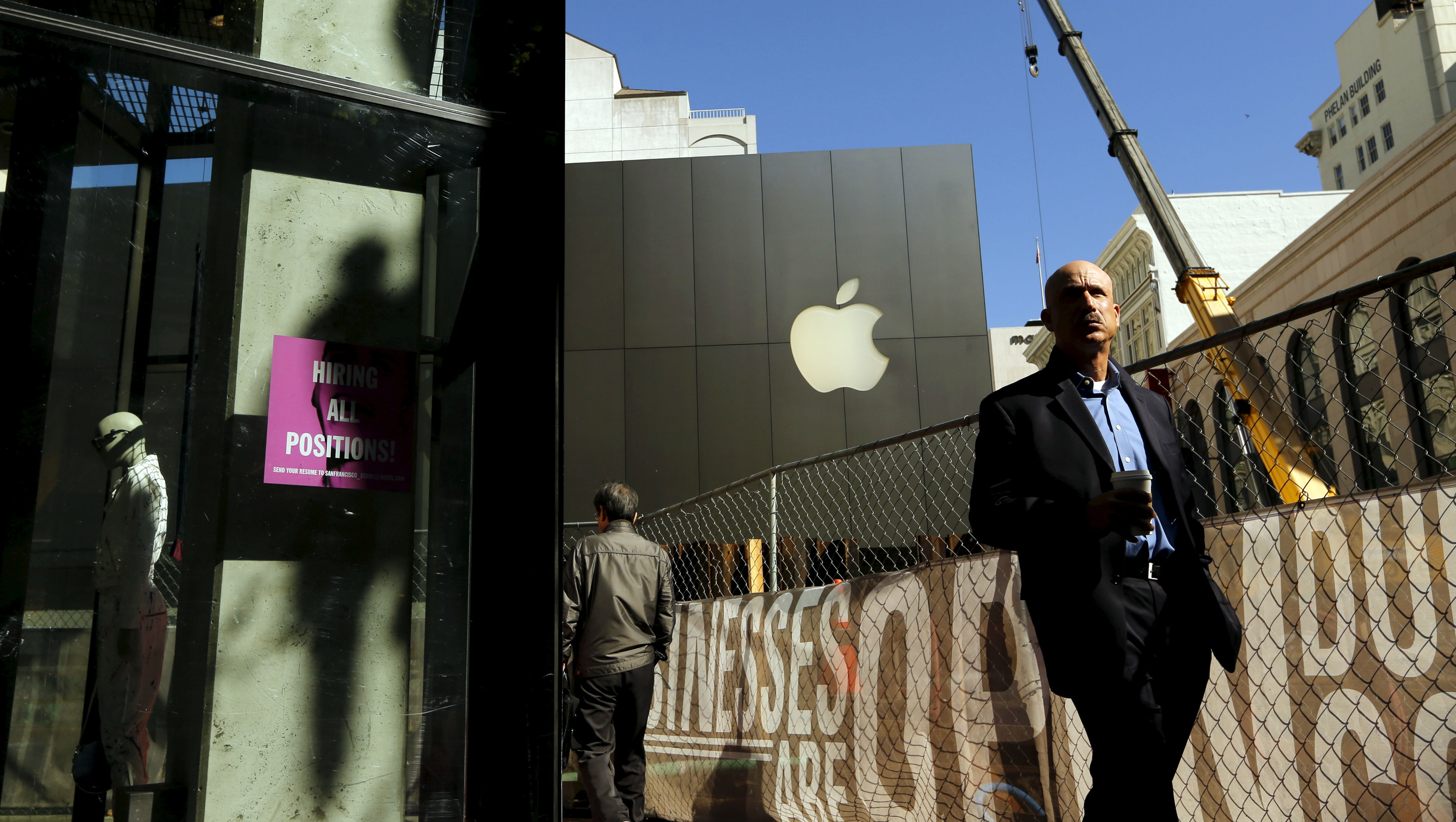 Pedestrians walk near the flagship Apple retail store in San Francisco, California April 27, 2015. Apple shares were up 1.1 percent at $13.59 ahead of its results, due after the close. Analysts expect Apple's quarterly revenue to rise 23 percent to $56.07 billion.  REUTERS/Robert Galbraith      TPX IMAGES OF THE DAY      - RTX1AJ25