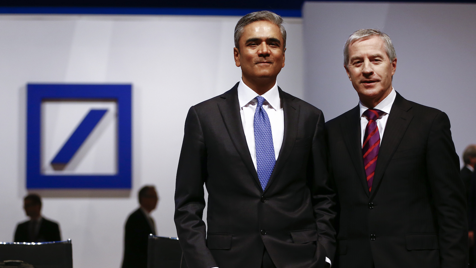 Anshu Jain (L) and Juergen Fitschen, co-CEOs of Deutsche Bank, pose before the bank's annual general meeting in Frankfurt, Germany, May 21, 2015. Deutsche Bank reshuffled its management board late on Wednesday, consolidating restructuring authority under co-Chief Executive Anshu Jain while bidding farewell to its retail banking head Rainer Neske. The reshuffle comes one day before the German bank holds what promises to be a stormy annual general meeting after shareholders openly expressed dismay at lagging profits, soaring fines and sluggish reforms.   REUTERS/Kai Pfaffenbach - RTX1DWK8