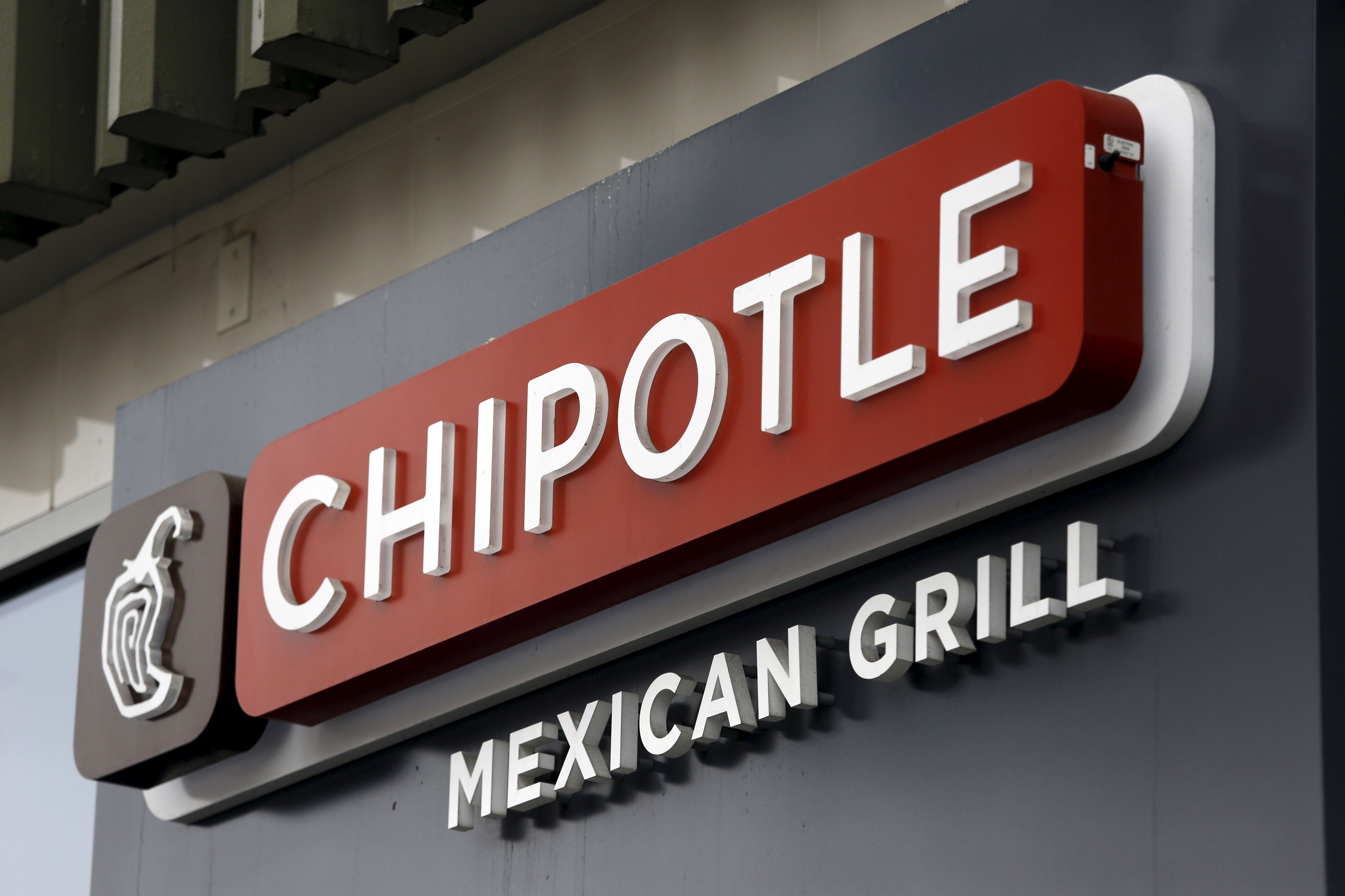 A sign is seen at a Chipotle Mexican Grill restaurant in San Francisco, California July 21, 2015. Burrito chain Chipotle Mexican Grill Inc reported lower-than-expected quarterly revenue on Tuesday.    REUTERS/Robert Galbraith - RTX1L9VH