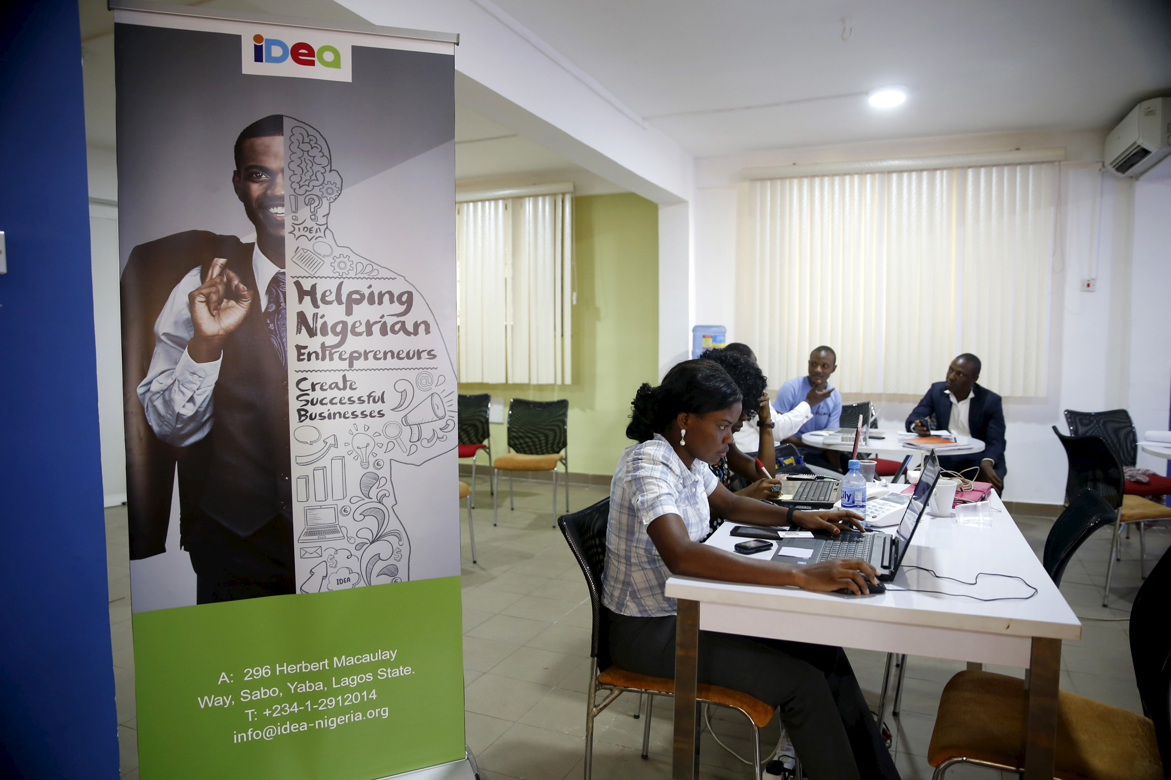 Software developers work on computer sytems at the Information Technology Developers Entrepreneurship Accelerator (iDEA) hub in the Yaba district in Lagos June 25, 2015. At first glance, Yaba is like many other parts of Nigeria's sprawling commercial capital: a cacophony of car horns and shouting street vendors, mingling with exhaust fumes and the occasional stench of sewage. But in between the run-down buildings in this seemingly inauspicious part of Lagos, a city of around 21 million, tech start-ups are taking root and creating a buzz that is drawing international venture capitalists and more established digital firms. Picture taken June 25, 2015.   - RTX1M6M2