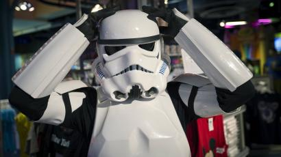 "A man dressed as a Storm Trooper character from ""Star Wars"" adjusts his helmet as he awaits people to purchase toys that are to go on sale at midnight in advance of the film ""Star Wars: The Force Awakens"" in Times Square in the Manhattan borough of New York, September 3, 2015."