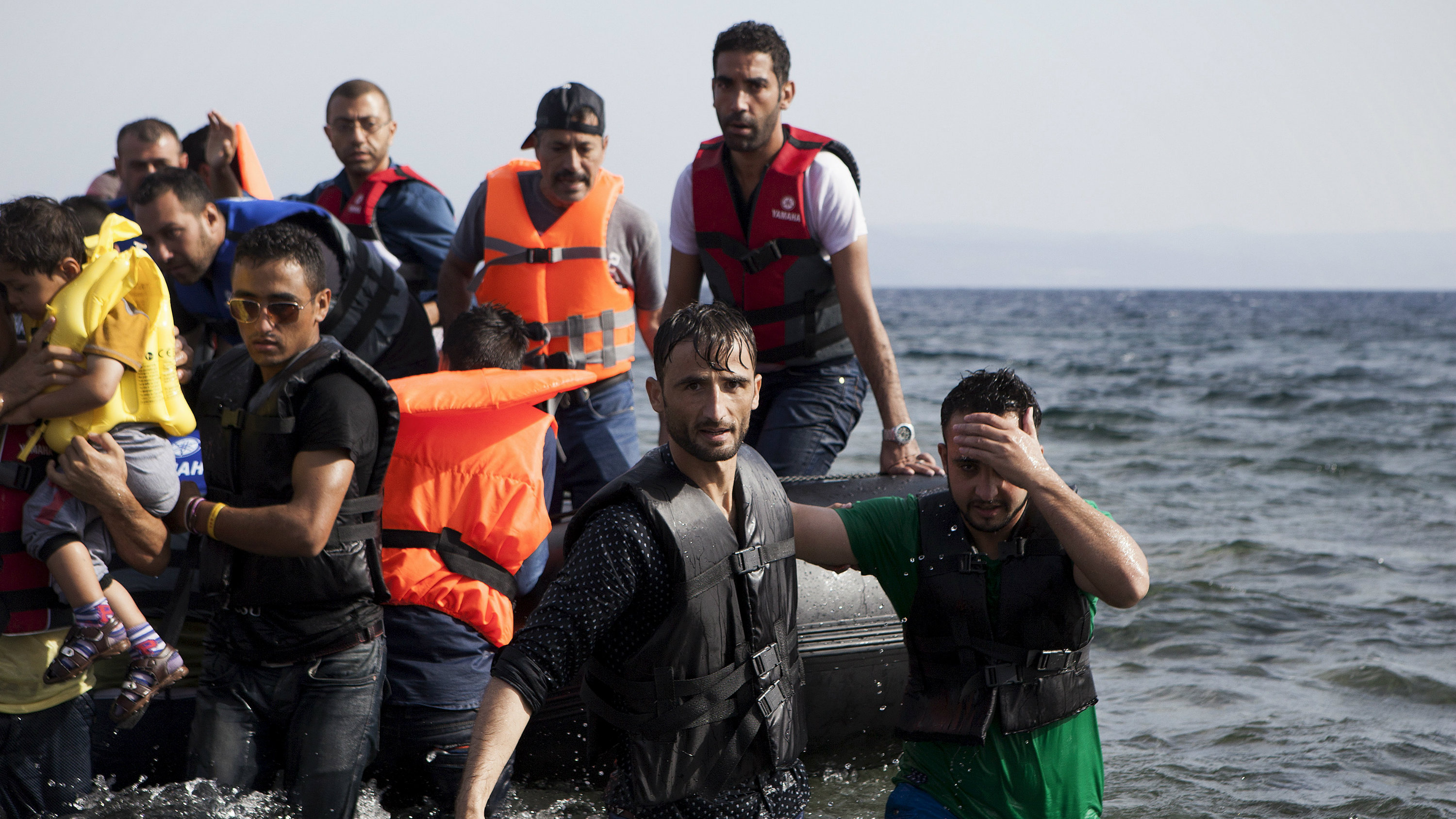 Syrian refugees arrive on a dinghy on the Greek island of Lesbos, September 7, 2015.