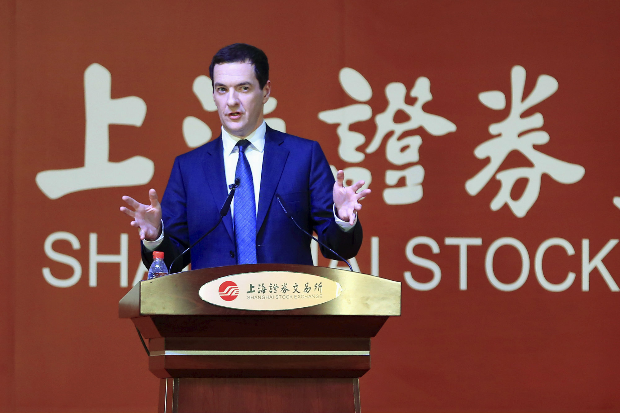 Britain's Chancellor of the Exchequer George Osborne delivers a speech at the Shanghai Stock Exchange..